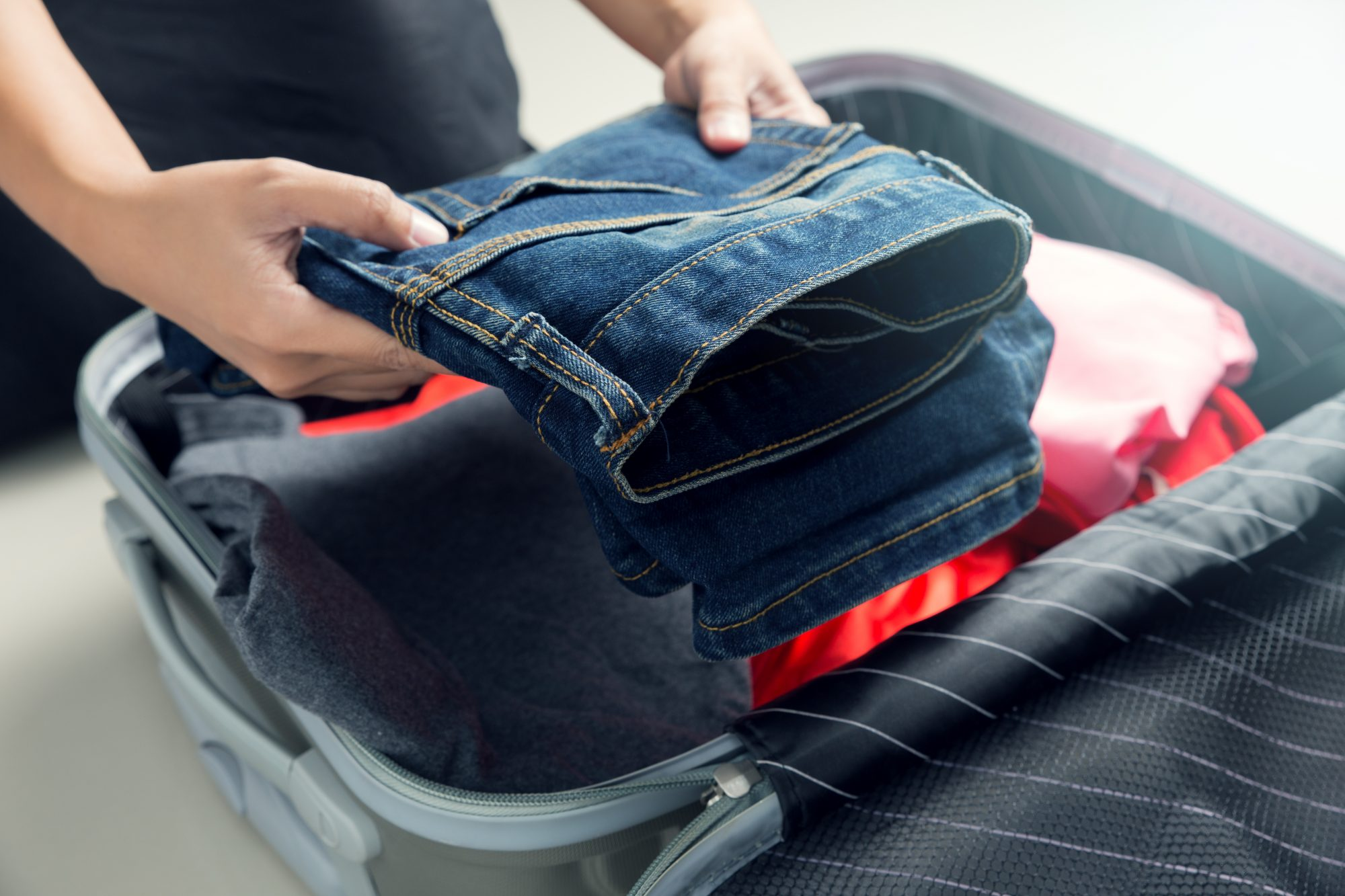 packing jeans in suitcase