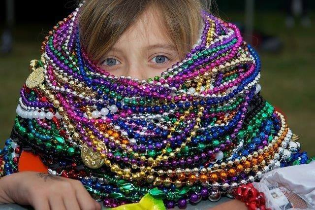 Child Covered in Party Beads