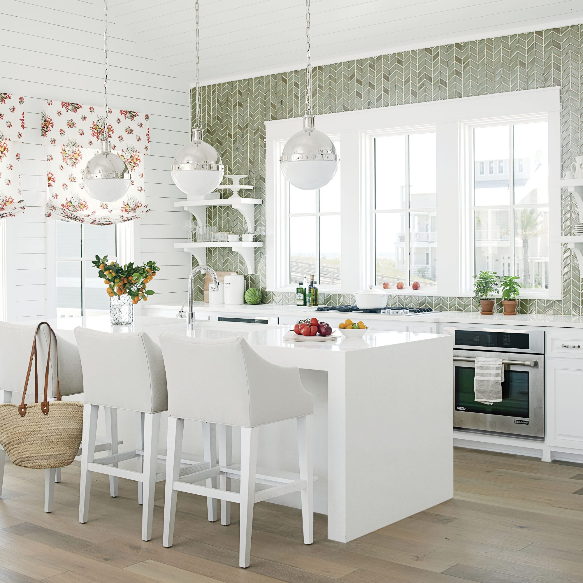 This kitchen reminds us of one of those movies with a star-studded ensemble cast that make it shine start-to-finish. Here, the stars are all manner of smart ideas: olive ceramic tile backsplash climbing all the way to the ceiling, big windows, and more.