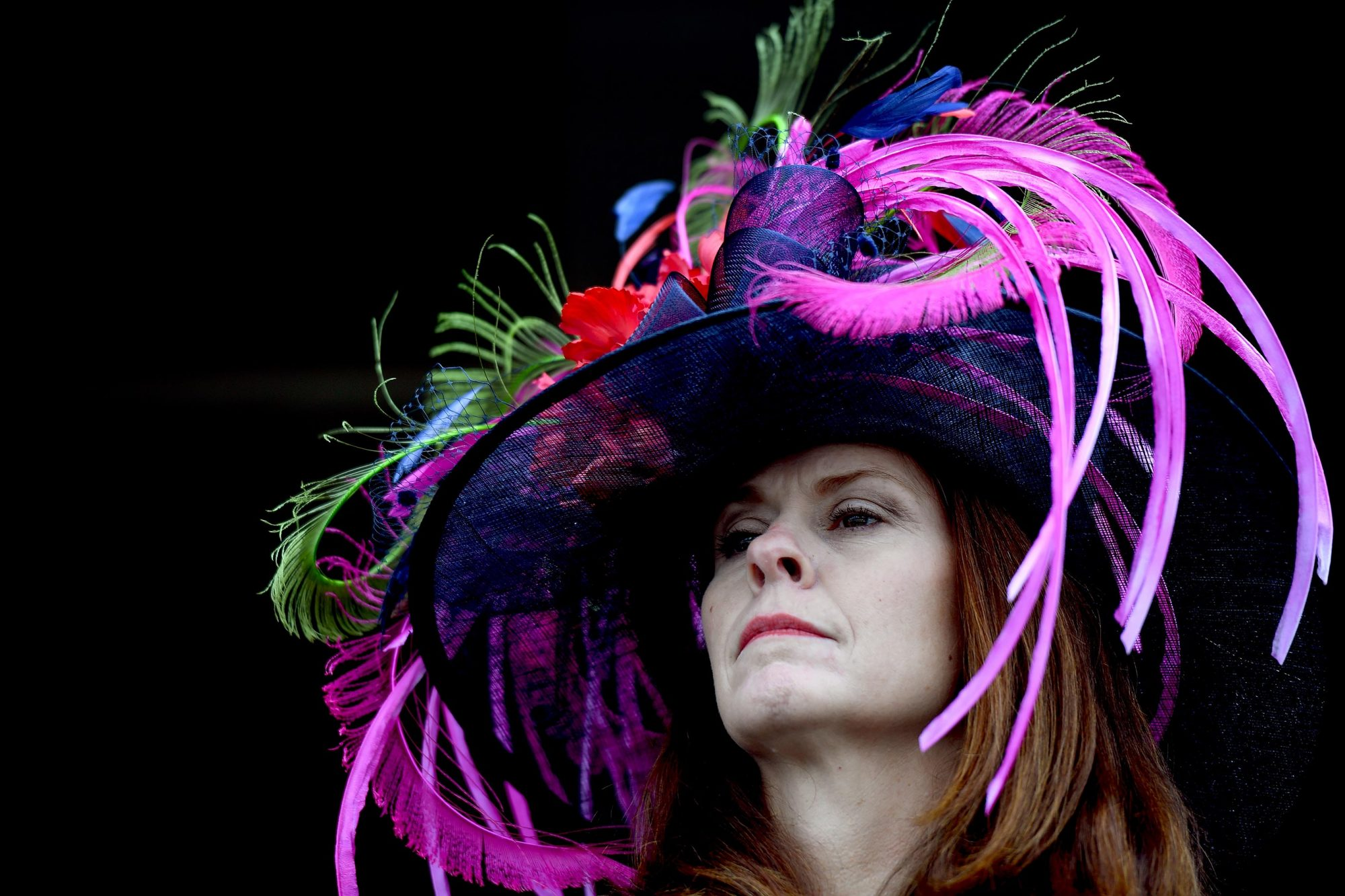 A woman prepares to watch the Kentucky Derby