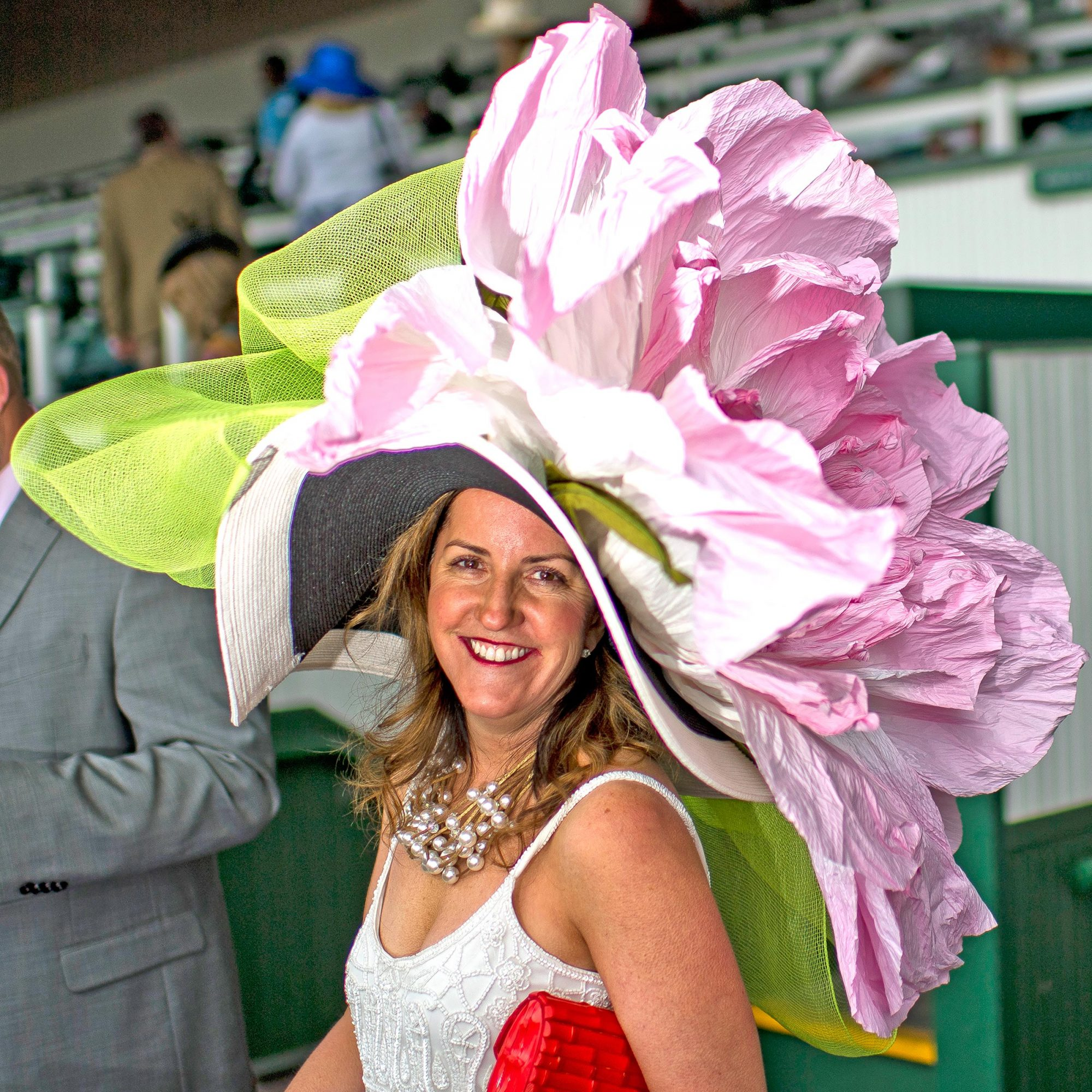 A woman wears a massive hat on Kentucky Derby Day