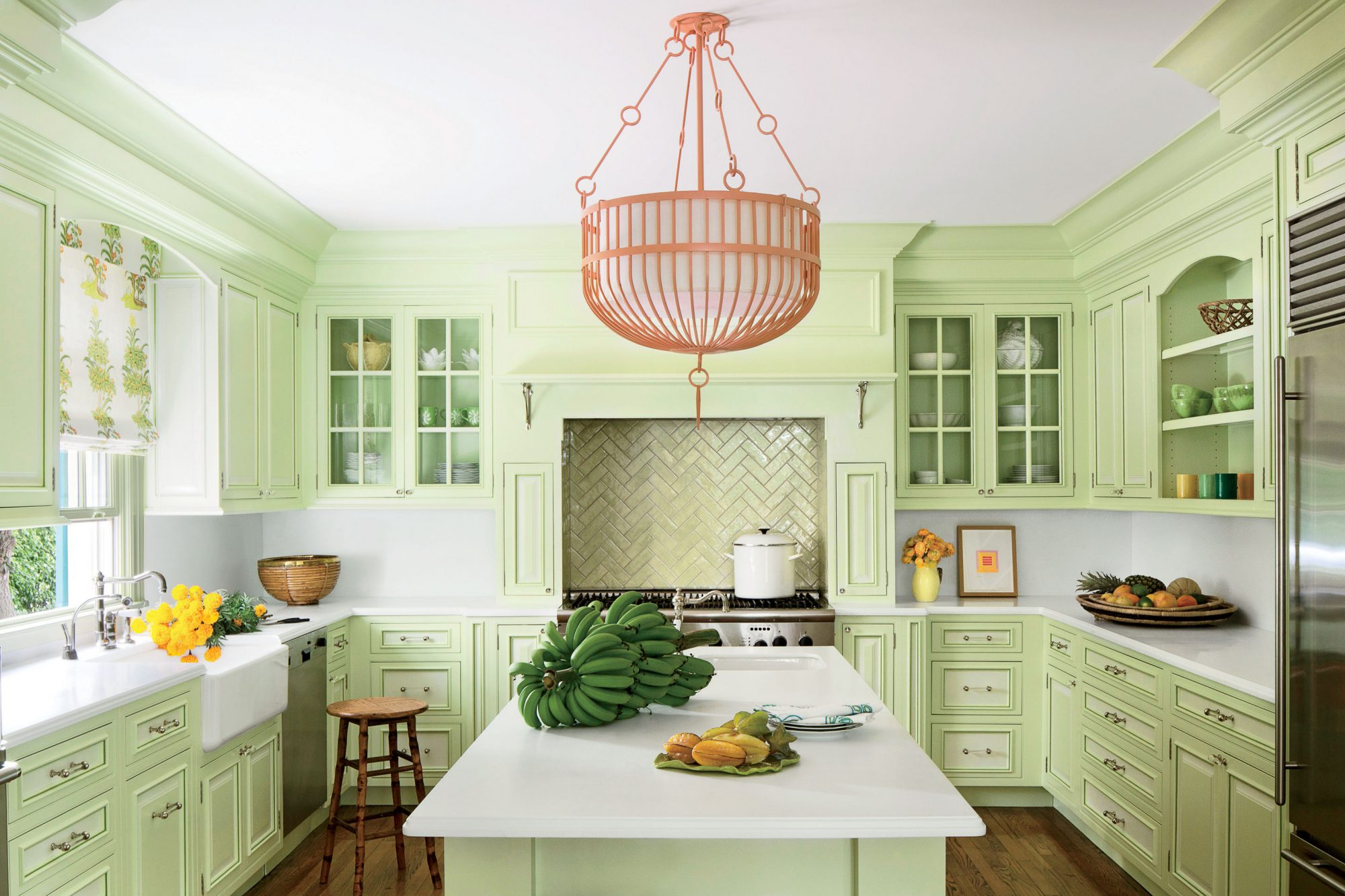 We're loving this Key lime color story. Play up the look with a backsplash that reflects the scheme, such as these glossy green tiles by Tiepolo Tileworks over the range. Stick with a neutral backsplash elsewhere to balance the design.