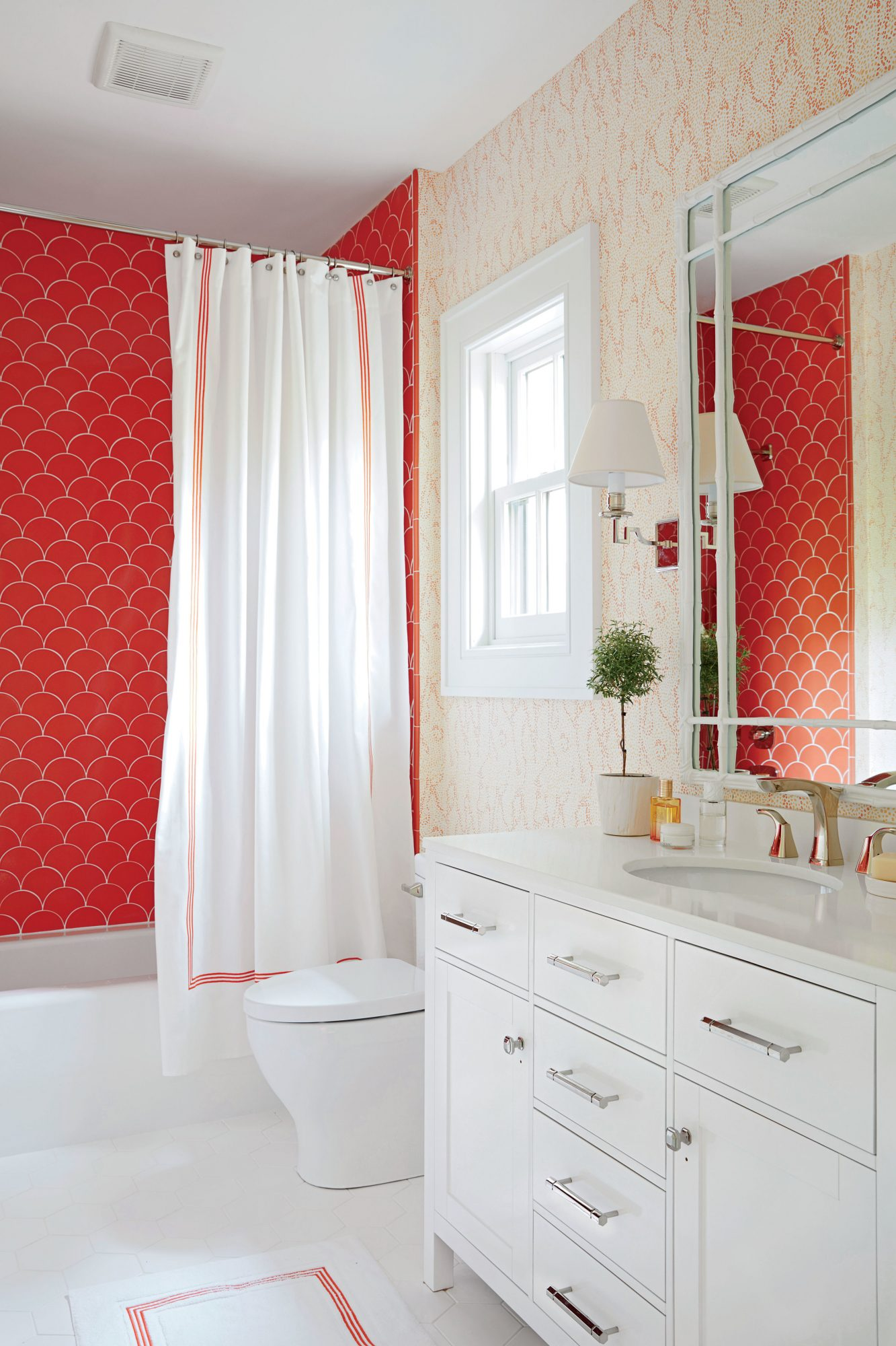 Bathroom #2: Rise & Shine Tiles. The half-arc pattern of these tangerine tub tiles is reminiscent of the rising sun, which is brilliant as a backdrop for morning soaks. Pair with a wallpaper smaller in scale but in the same color family.