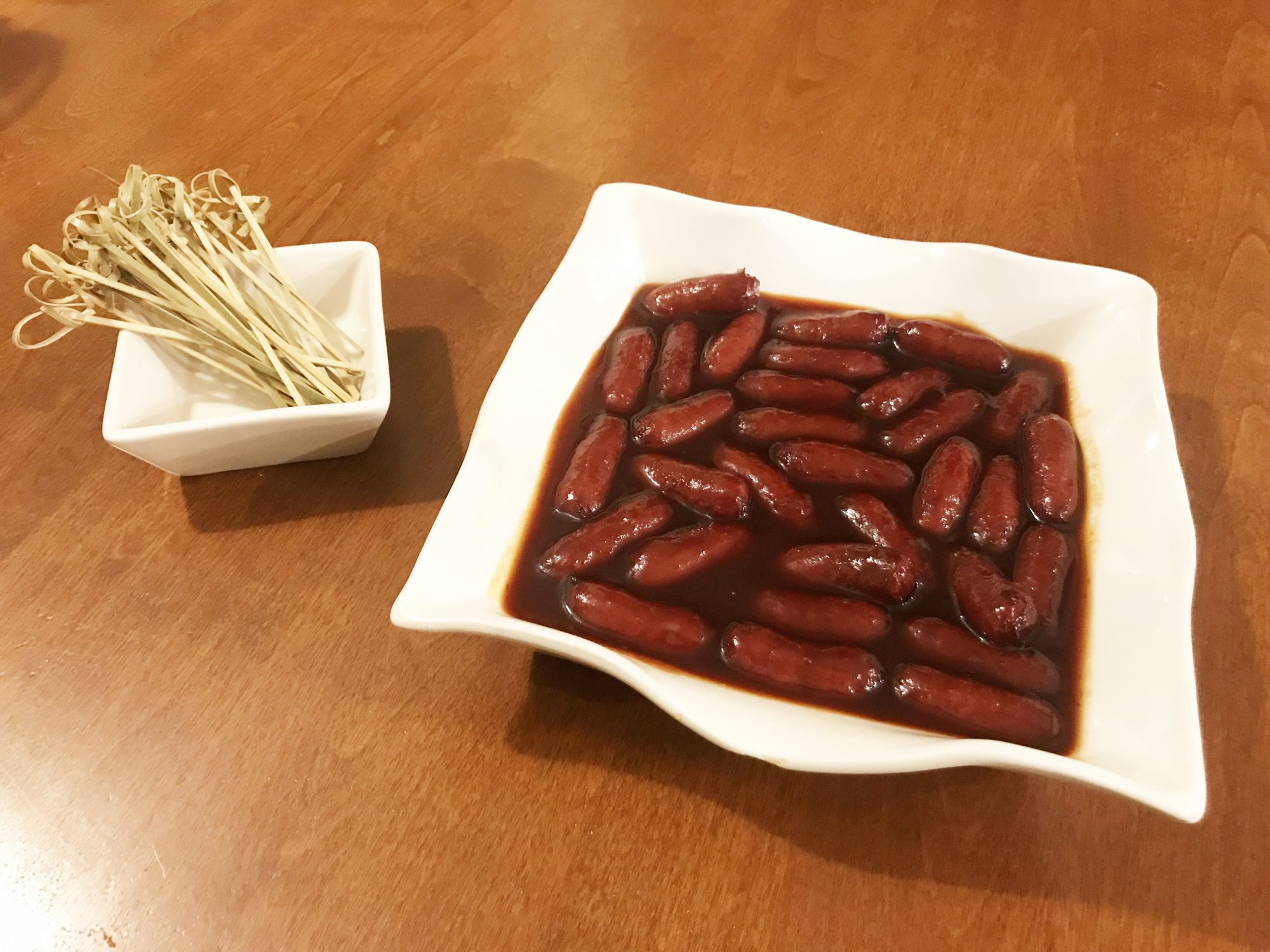Little Smoked Sausages in Grape Jelly and Chili Sauce
