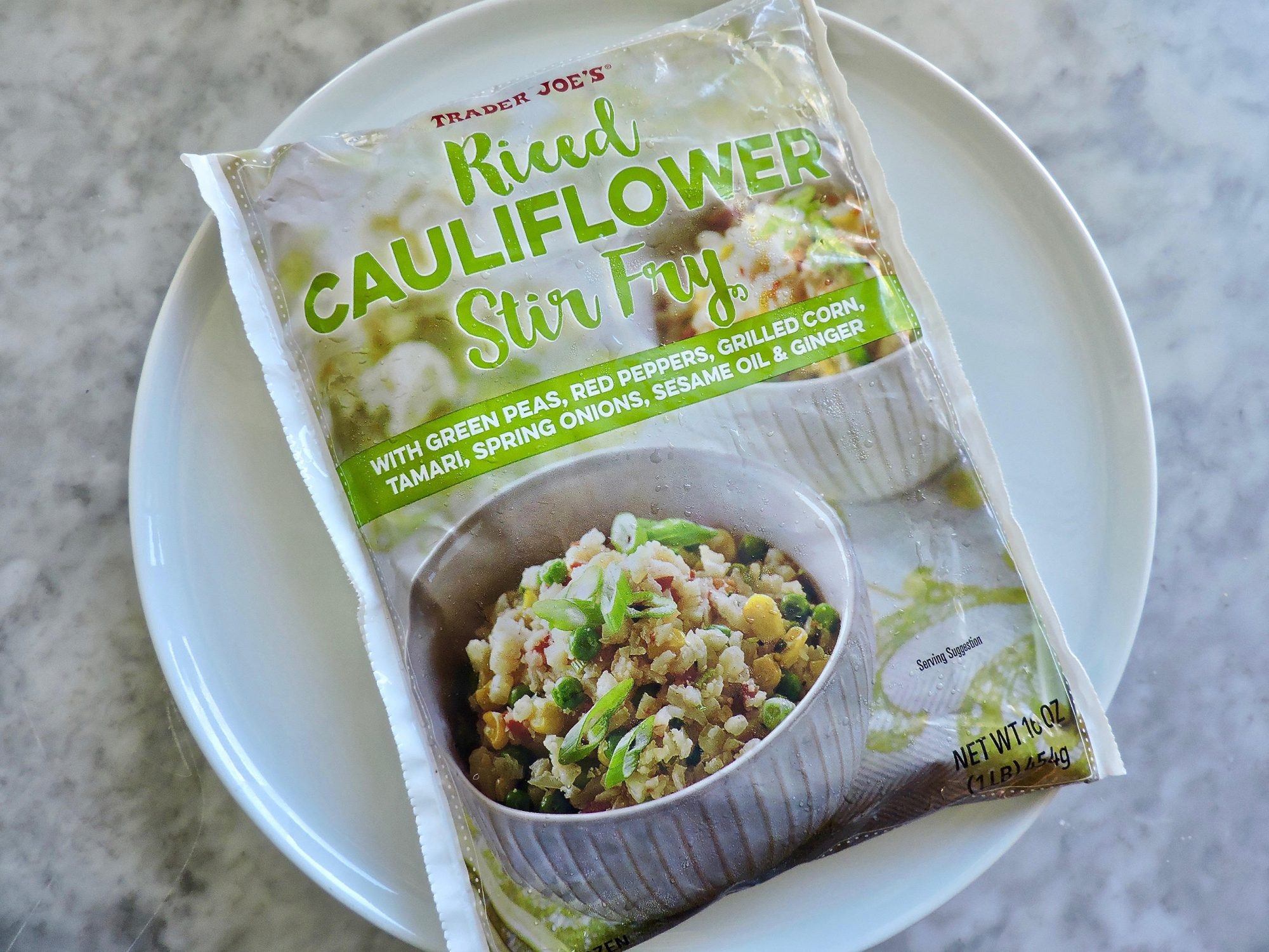 15 Nutritionist-Approved Trader Joe's Foods for $5 or Less 1804w-Riced-Cauliflower-Stir-Fry