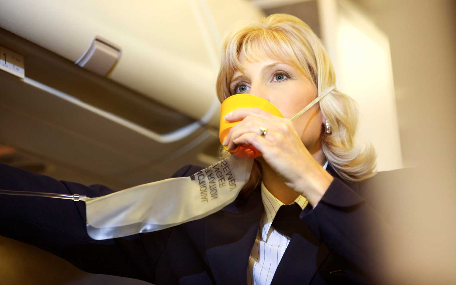 Woman Inflating Oxygen Mask