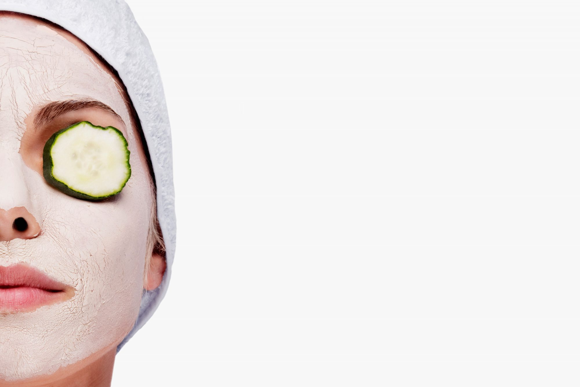 Woman Wearing Face Mask with Cucumbers