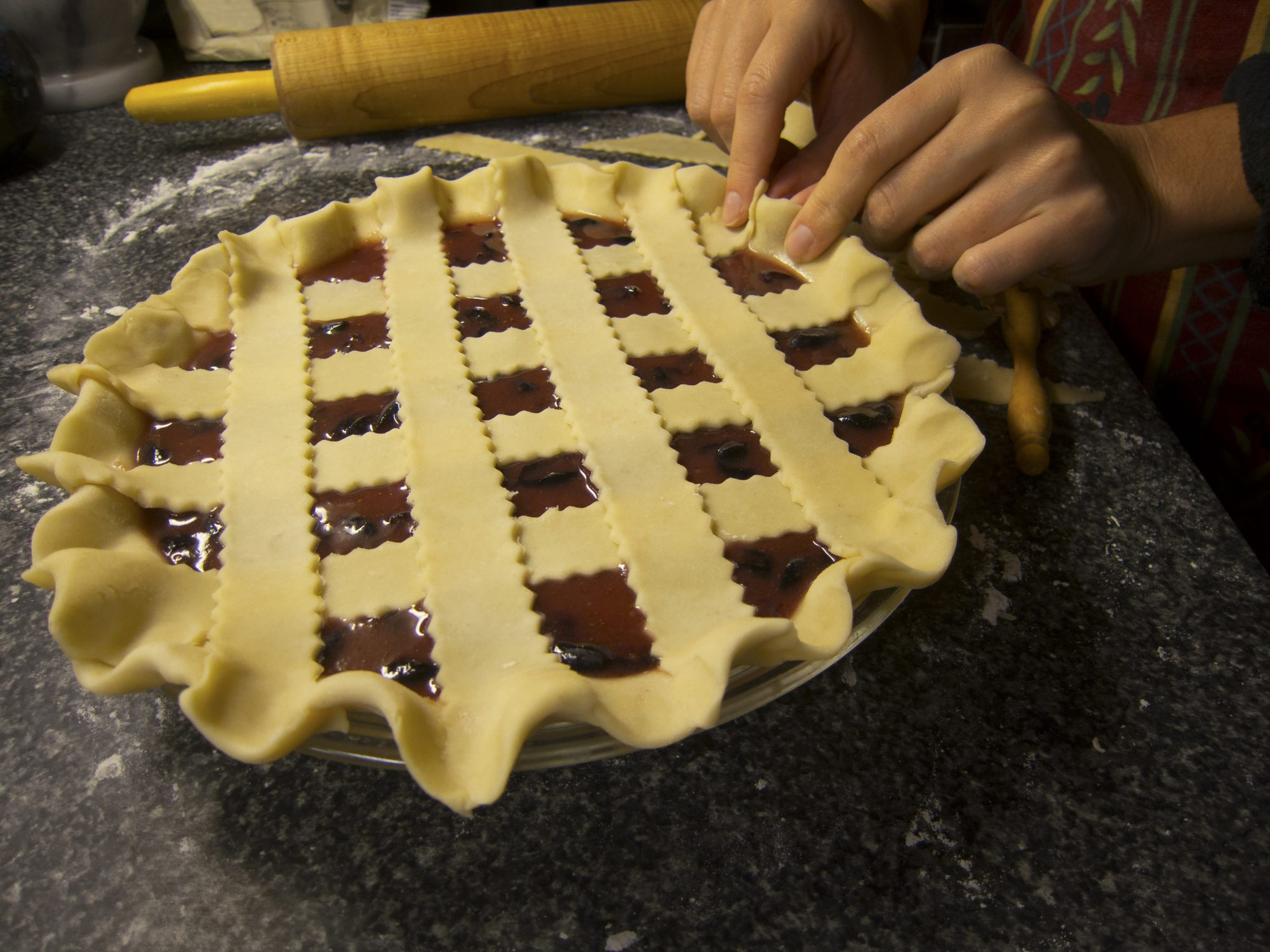 Hands Fitting Pie Dough into Pie Plate