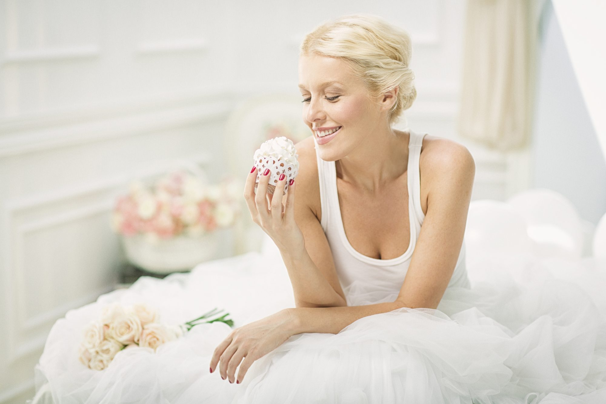 Bride Eating Cupcake While Getting Ready