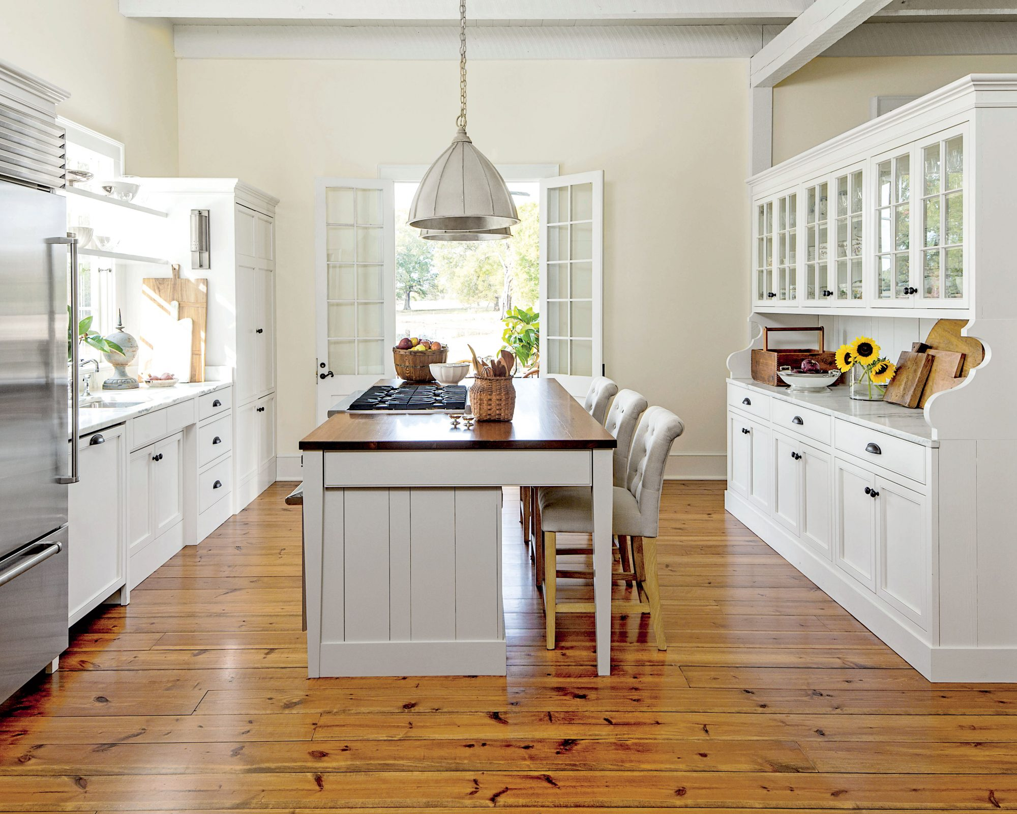 White Kitchen with Honey Tone Wood Floors