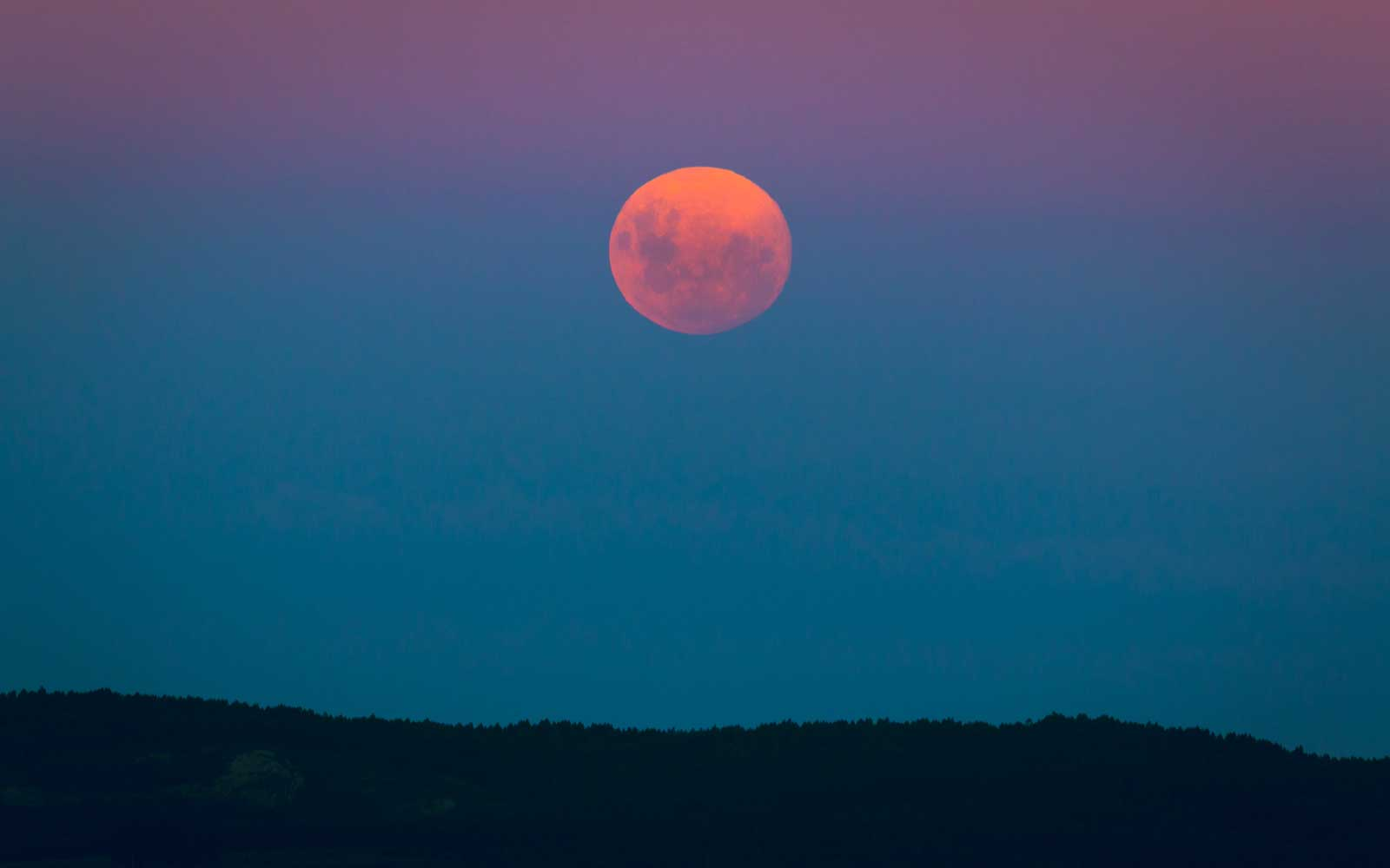 Full moon rising over a hill, Rocha, Uruguay
