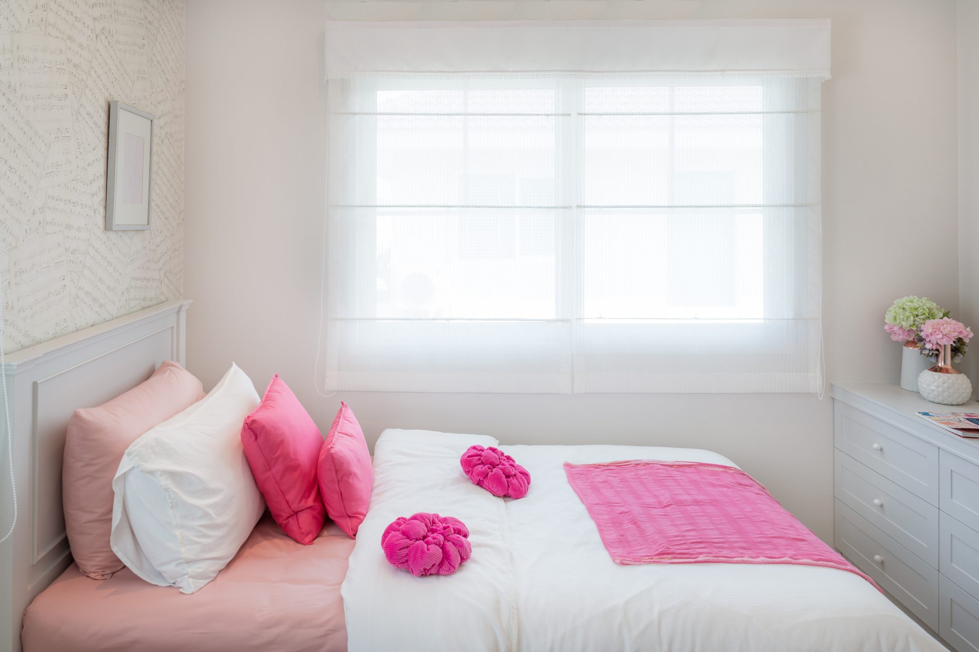 Small White Bedroom with Pink Details