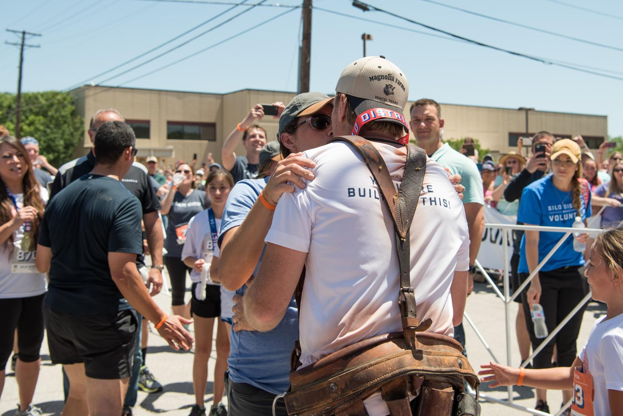 Chip Gaines Reveals the Incredible Reason He Wore His Toolbelt While Running His Marathon silo-district-marathon-chip-gaines-joanna-gaines-running-finish-line-brave-like-gabe-toolbelt-waco