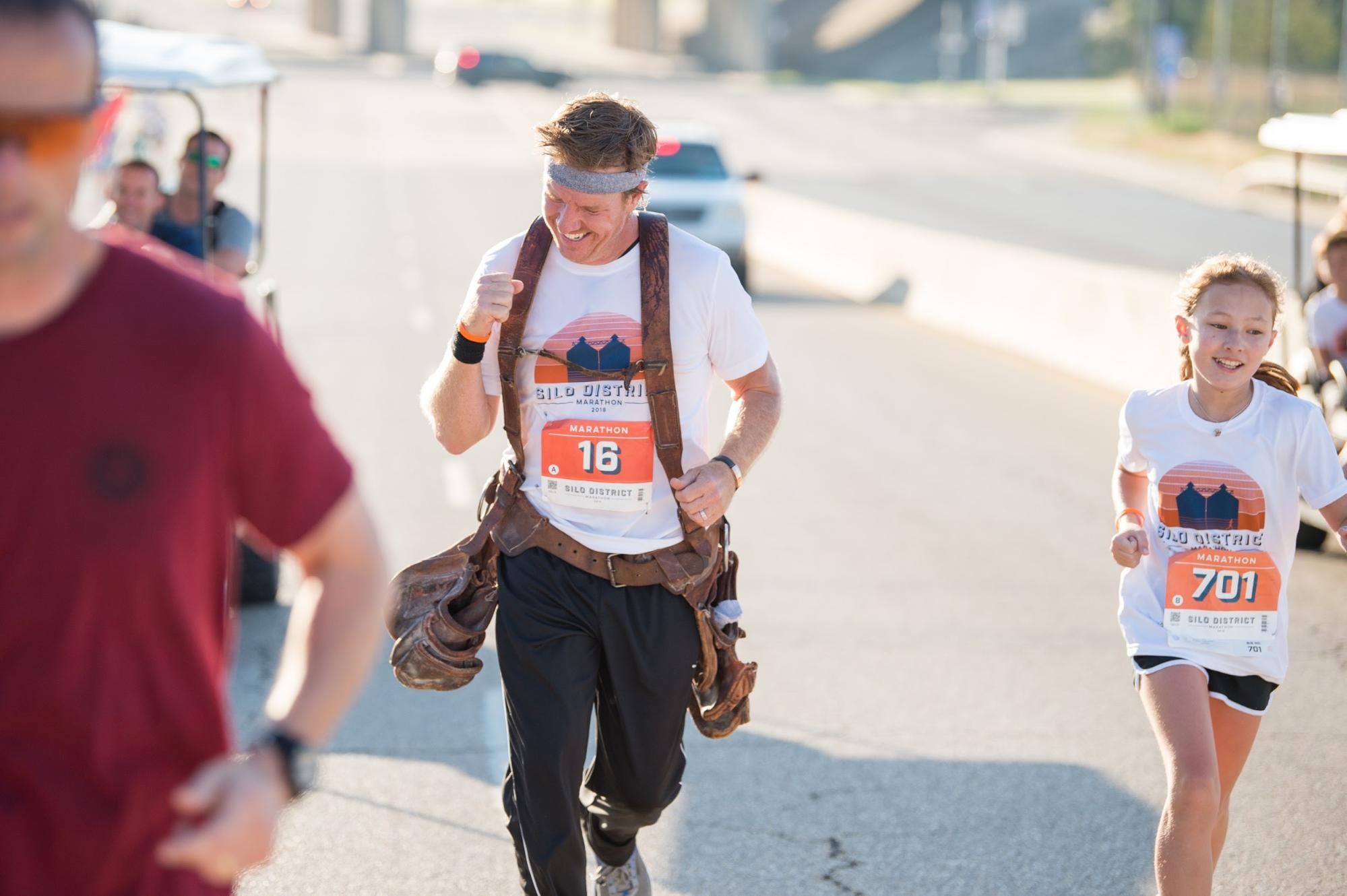 Chip Gaines Reveals the Incredible Reason He Wore His Toolbelt While Running His Marathon silo-district-marathon-chip-gaines-running-with-daughter-toolbelt-waco