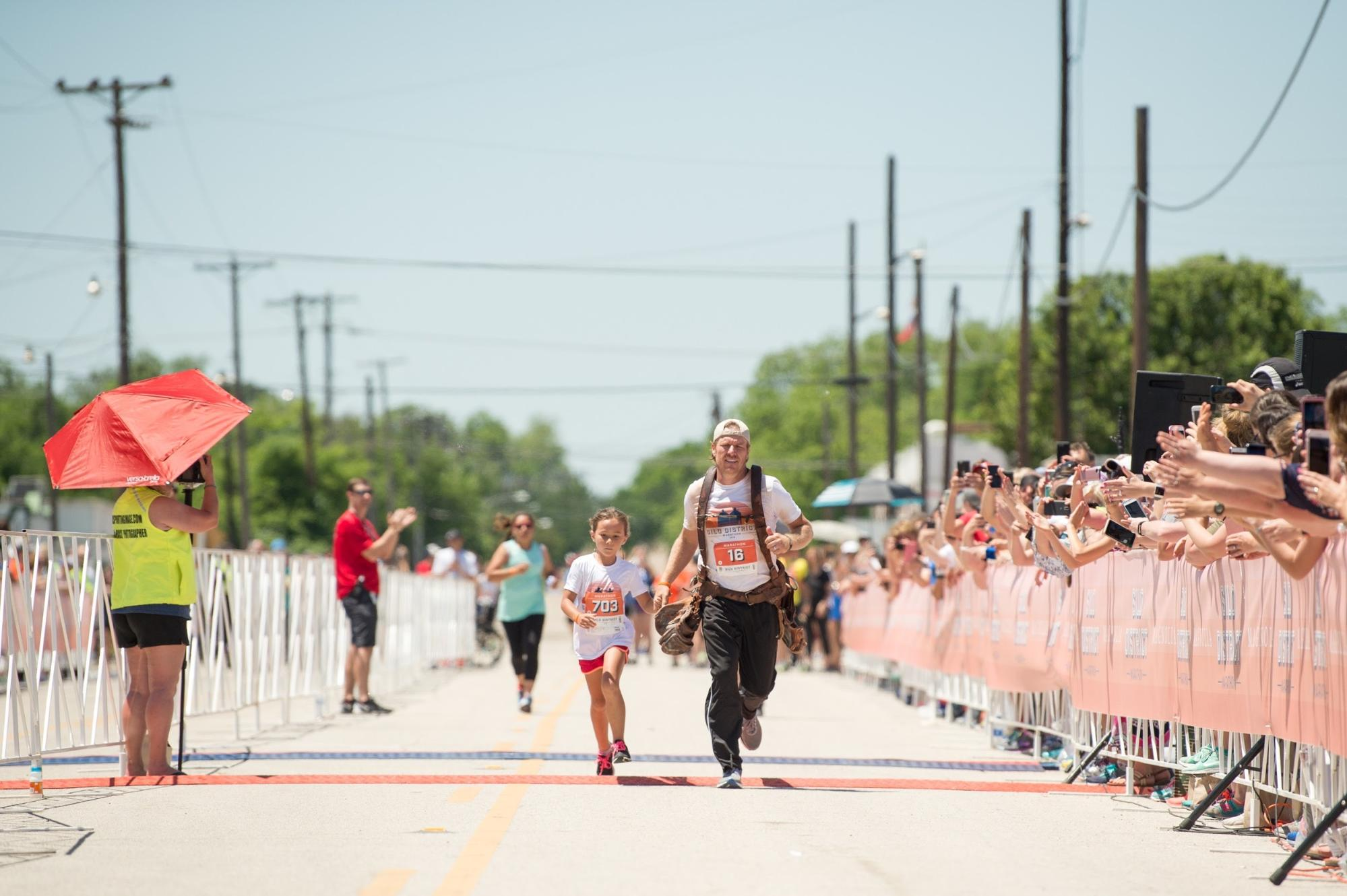 Chip Gaines Reveals the Incredible Reason He Wore His Toolbelt While Running His Marathon silo-district-marathon-chip-gaines-running-with-family-daughter-finish-line-brave-like-gabe-waco