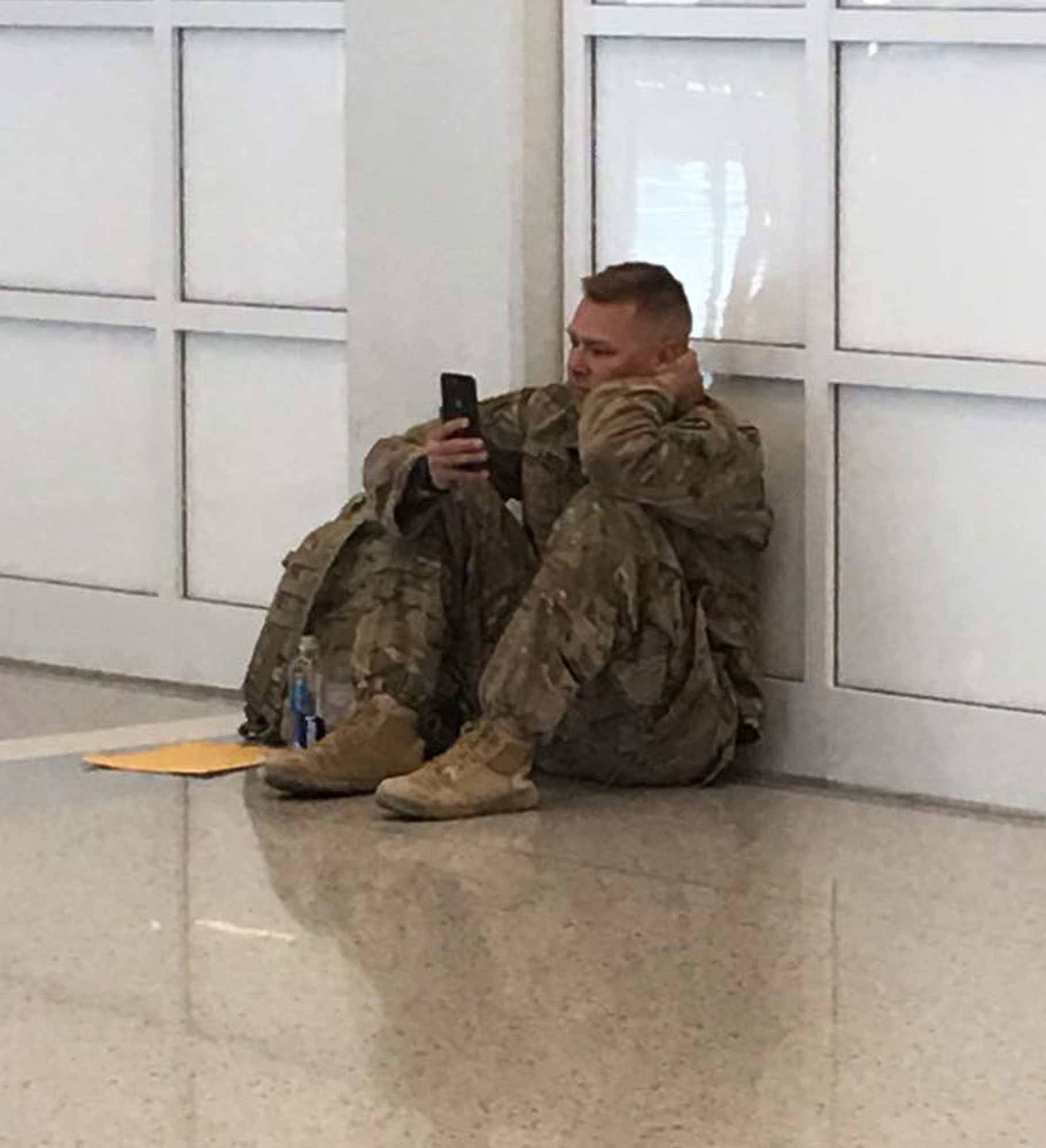 Soldier Stuck in Airport Watches Wife Give Birth to Daughter Over FaceTime: 'We Were All Cheering' soldier-facetime
