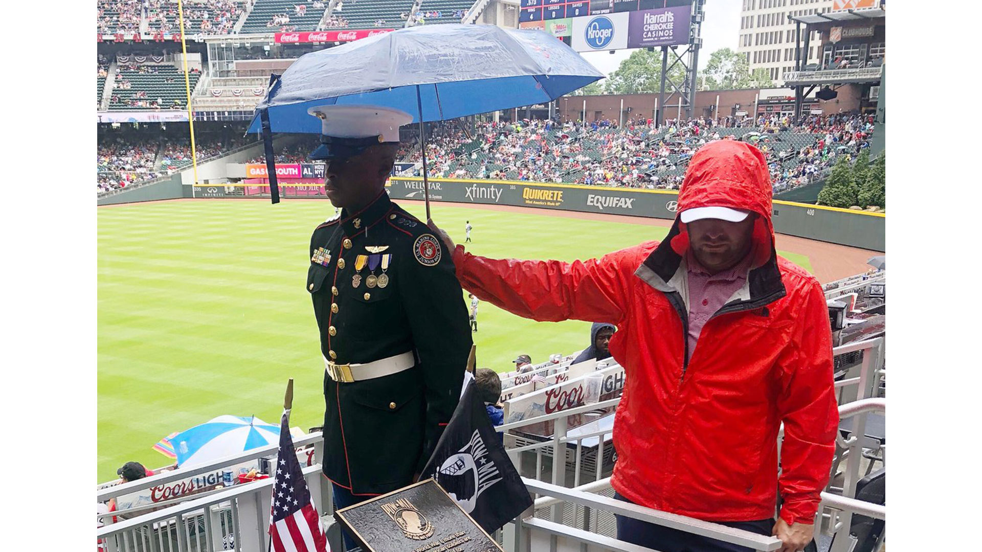 Moving Photo of Braves Fan Holding Umbrella for Marine Corps Junior ROTC Cadet Goes Viral