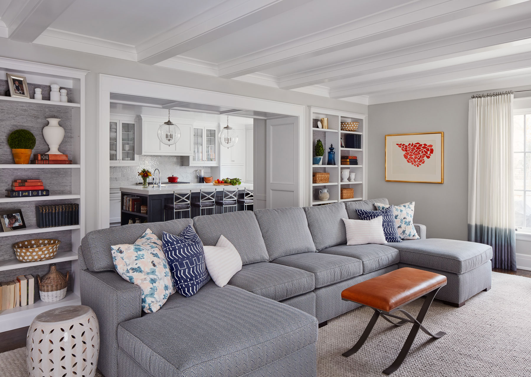 The family room feels much more like the kitchen than the more entertaining-focused living room and foyer, with soft textures and more neutral tones (though there are still plenty of touches of blue).