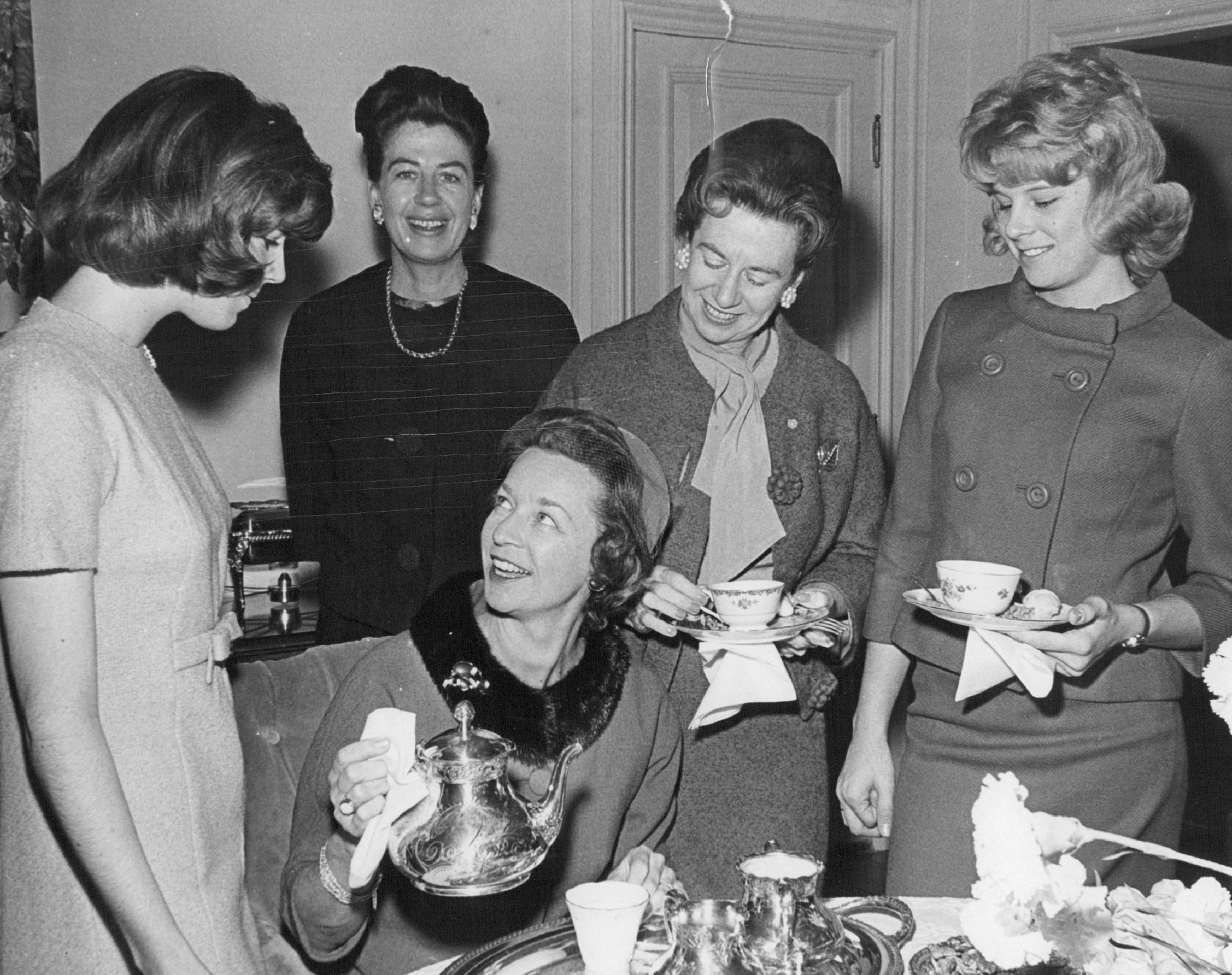 Woman Pouring Tea at Party