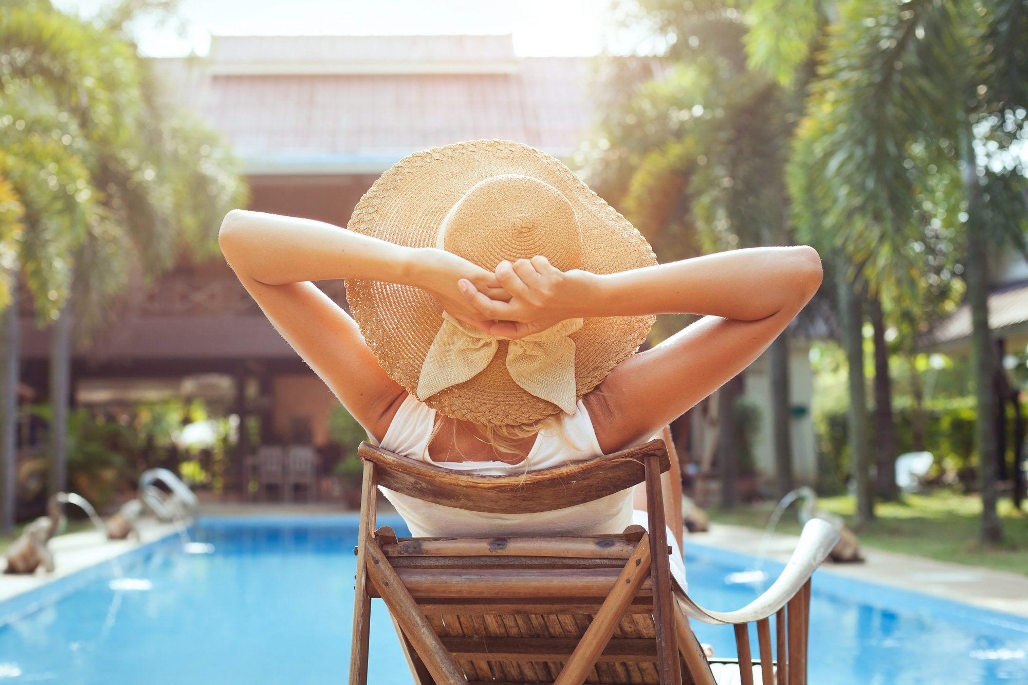 Woman Enjoying Hotel Pool