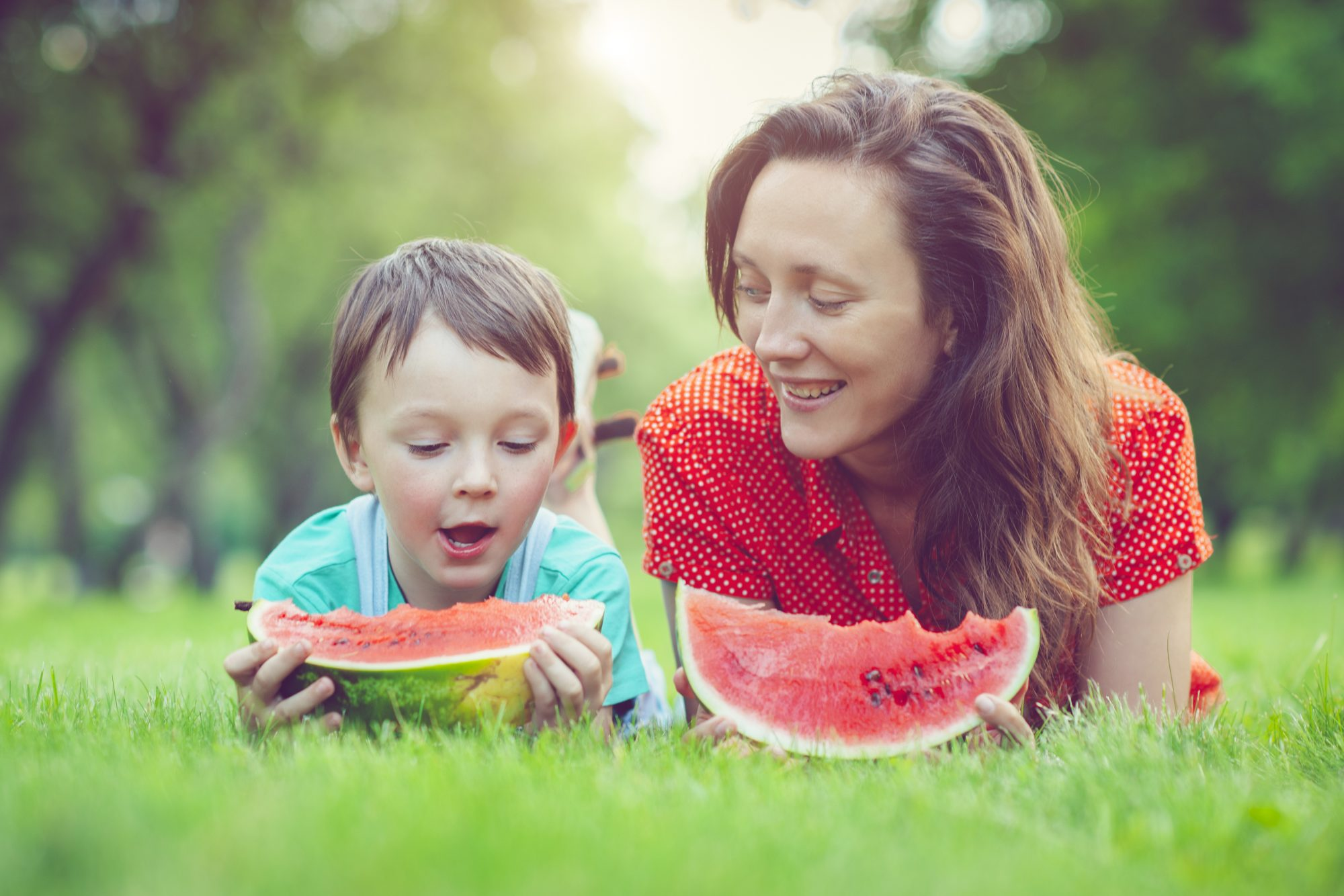 Boy and Mother Eating Watermelon