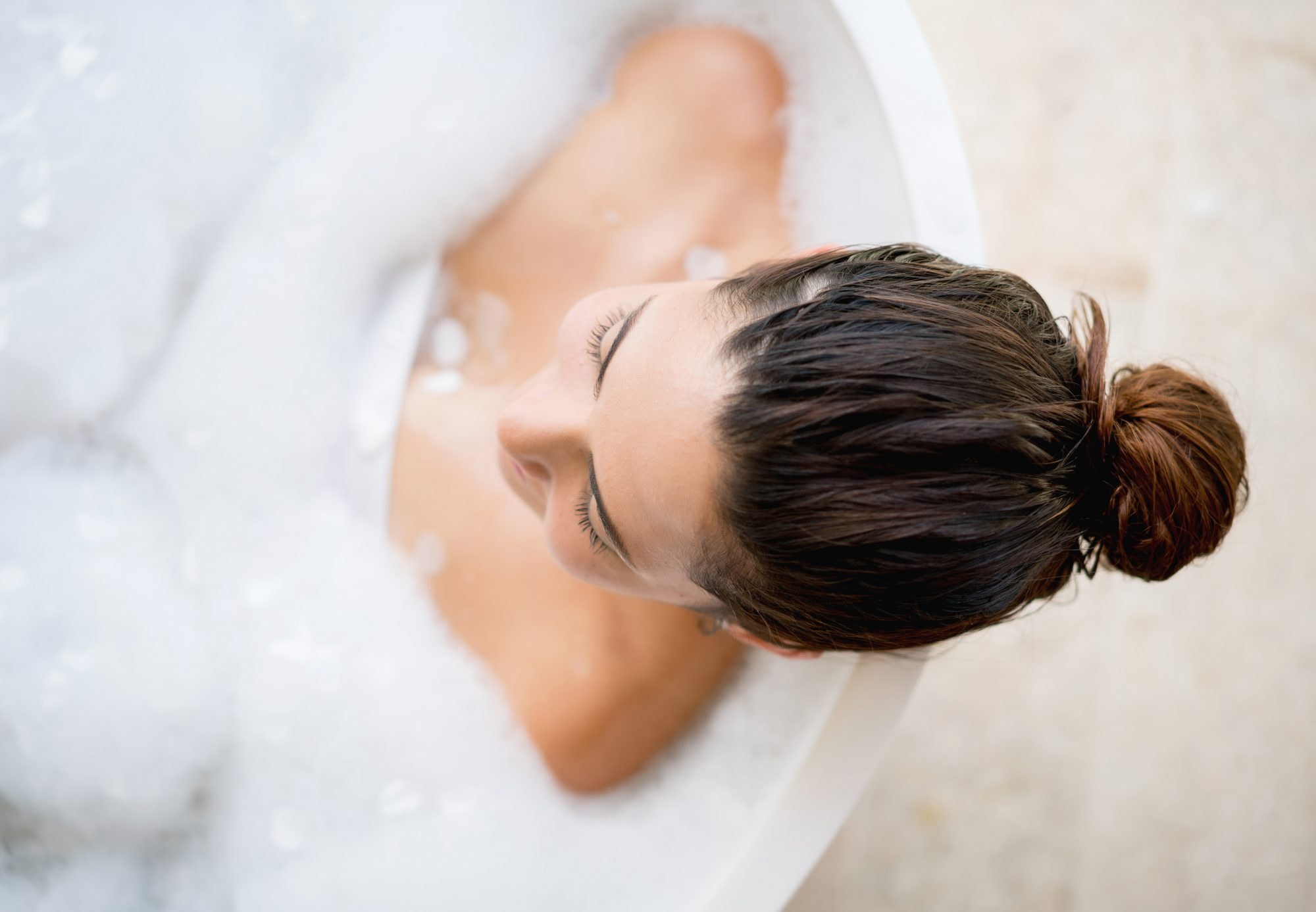 Brunette Woman Taking Bubble Bath