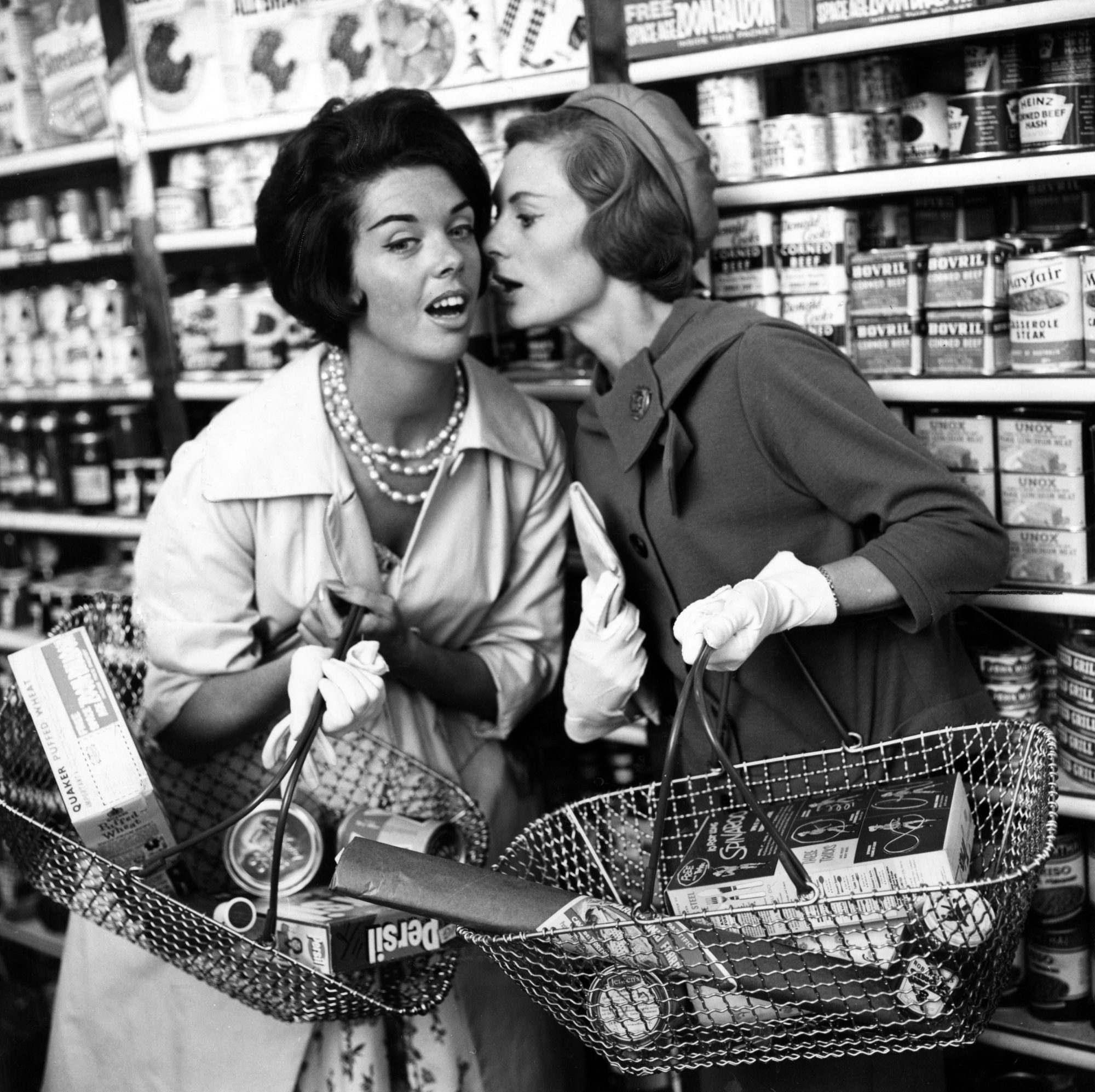 women gossiping in supermarket