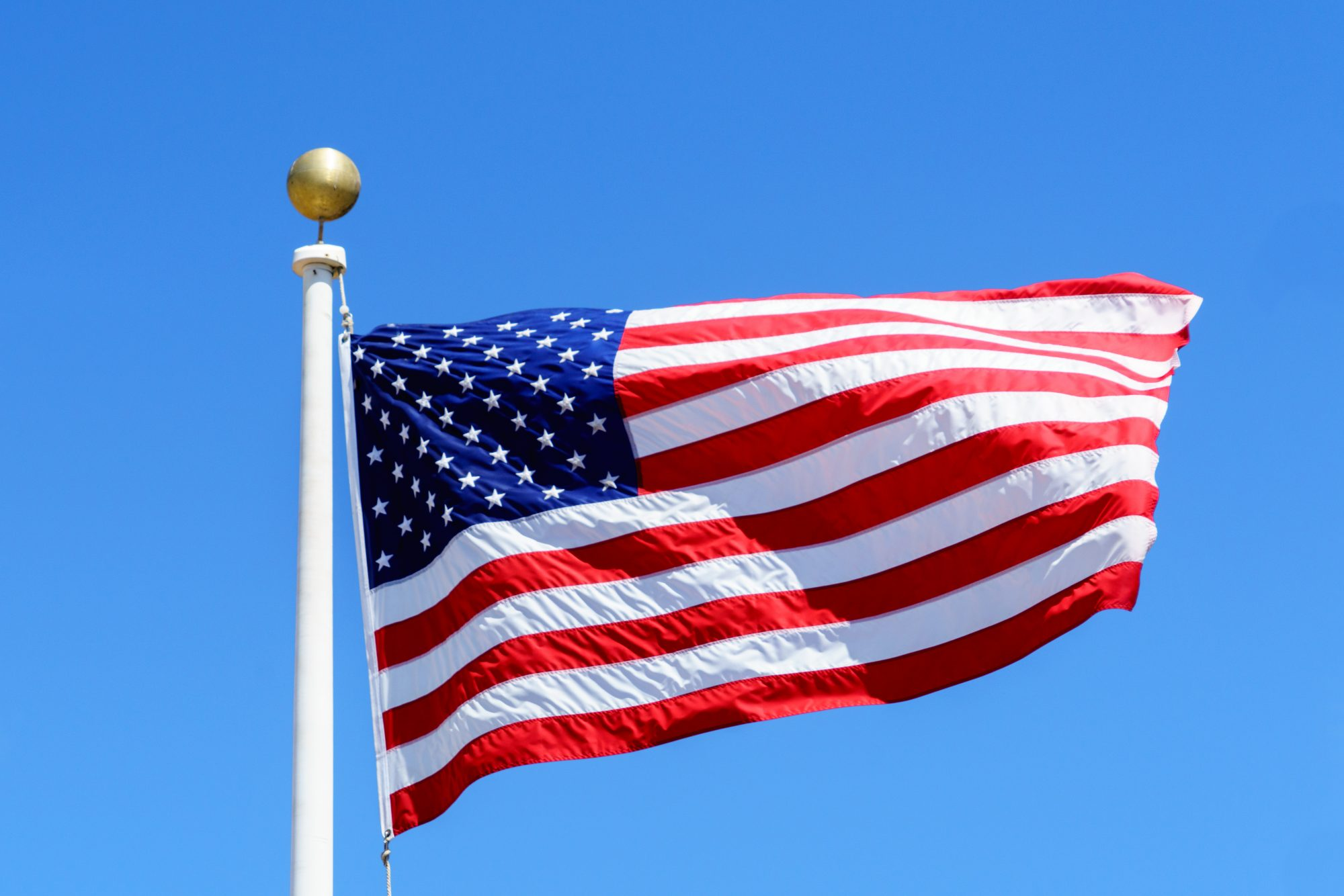 American Flag and Sky Background