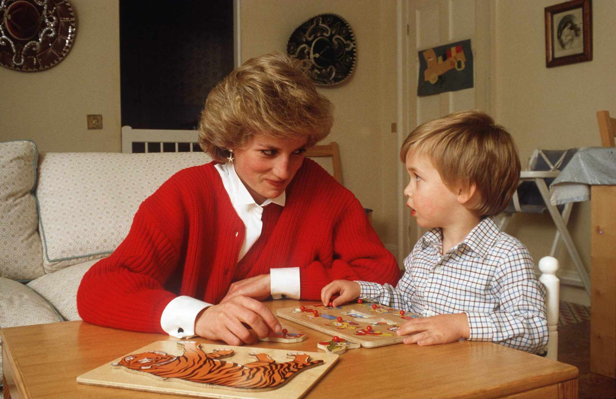 Princess Diana and Prince William Play with a Puzzle