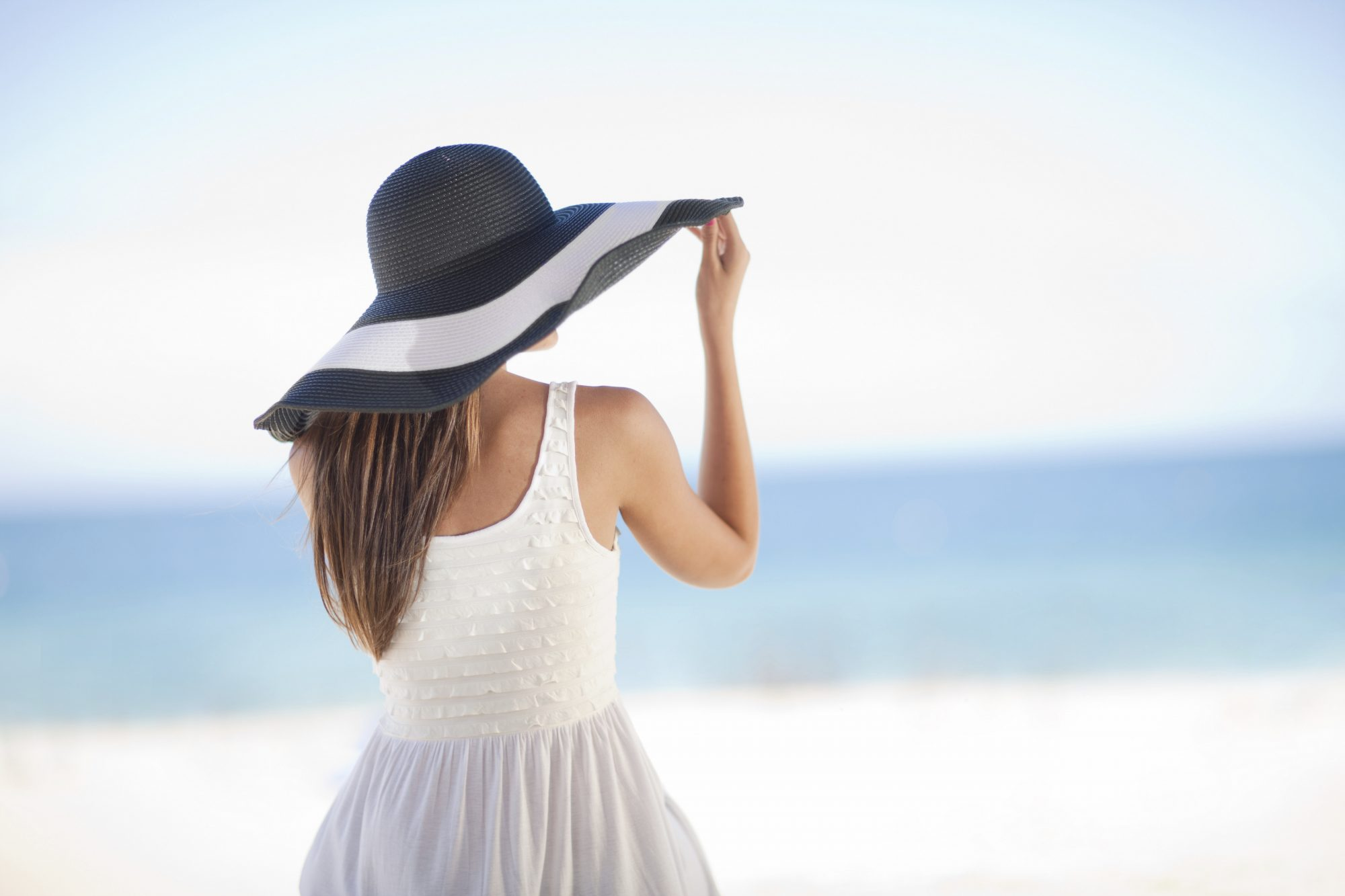 Woman in Sunhat and White Dress