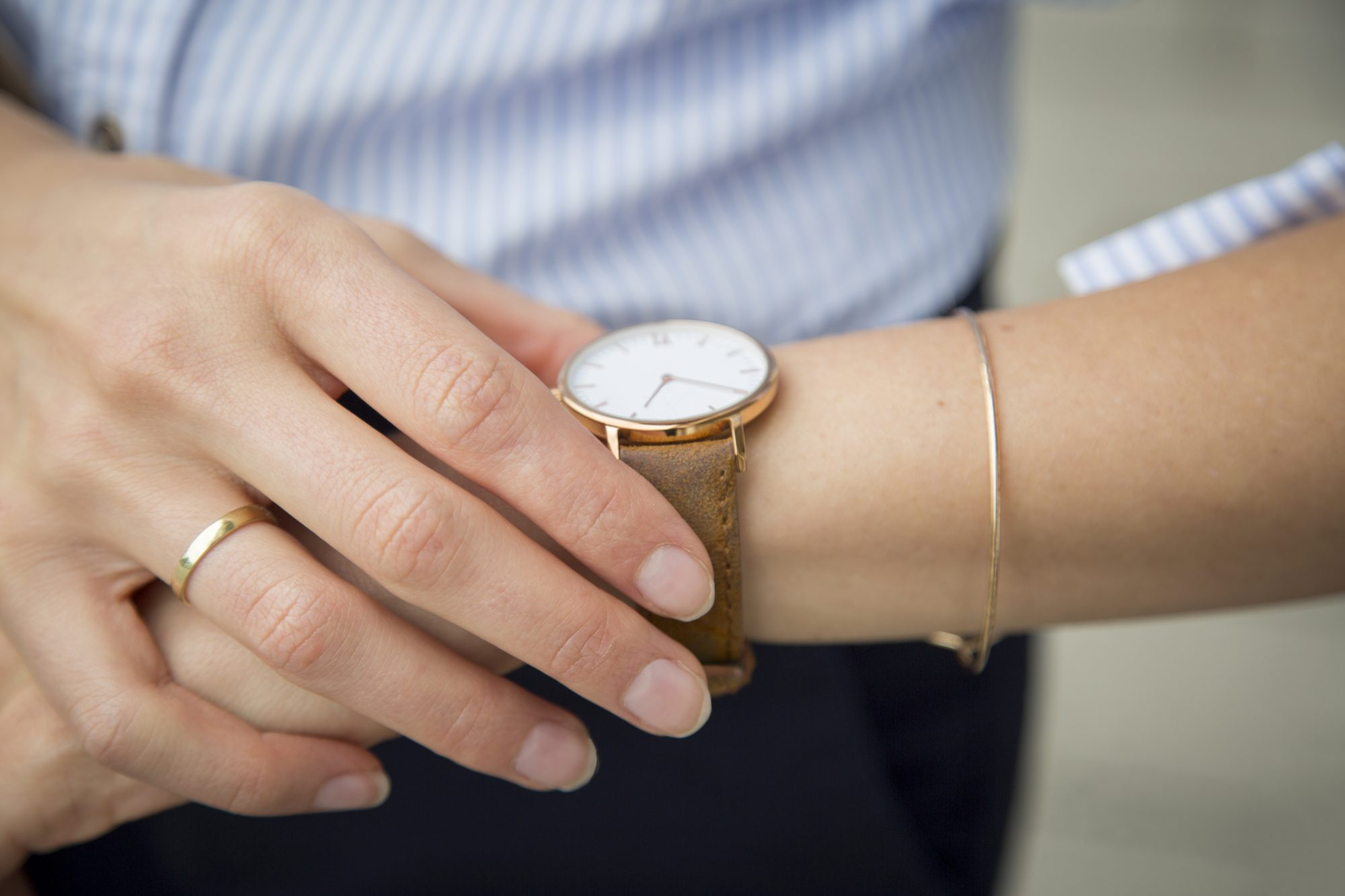 Woman Looking at Watch