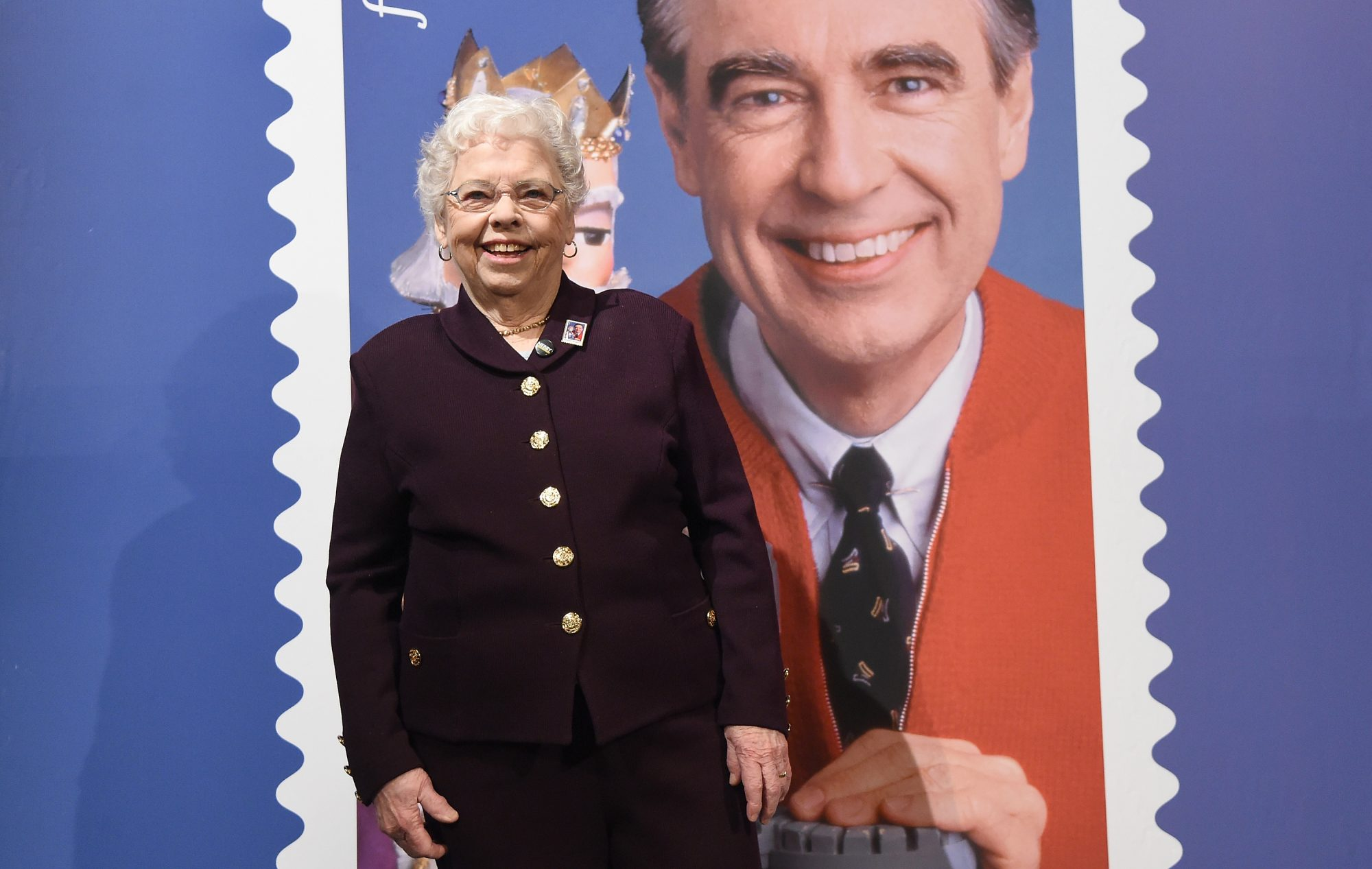 Joanne Rogers in front of Fred Rogers Photo