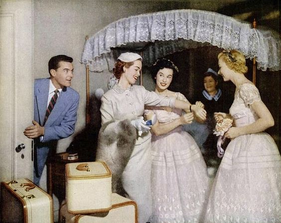 Vintage Bride Travel Clothes with Bridesmaids and Suitcases