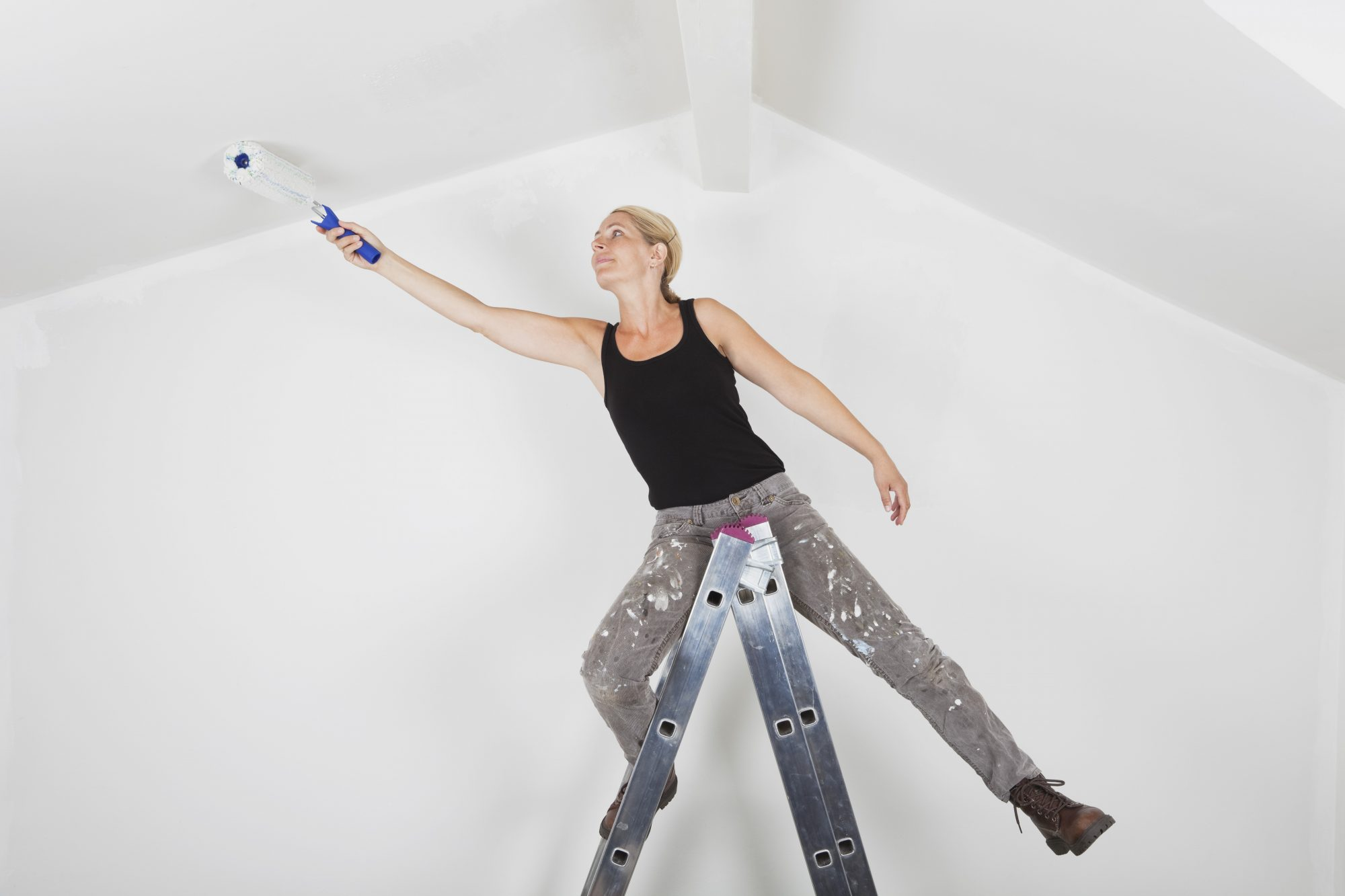 Woman Painting Ceiling
