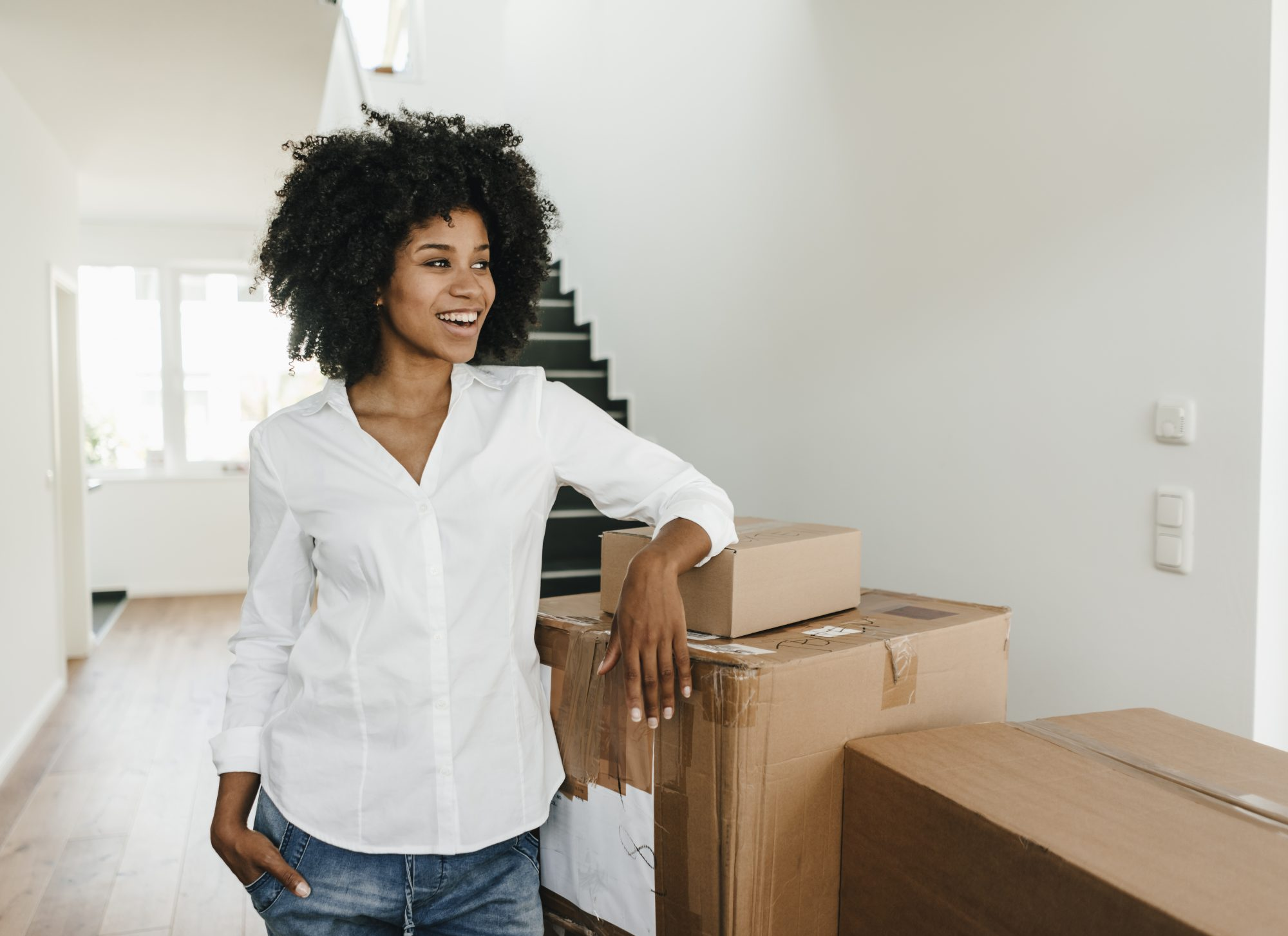 Woman in Home with Boxes