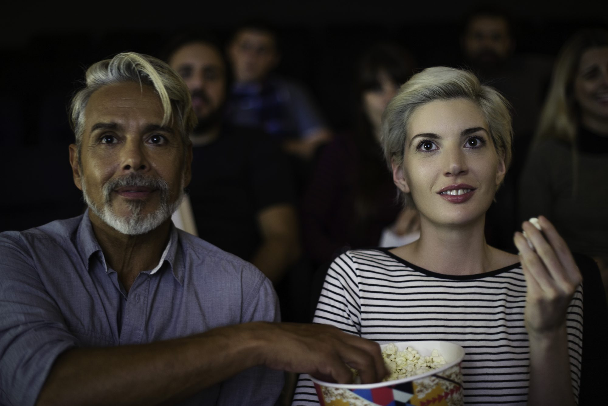 Couple at Movies with Popcorn Bucket