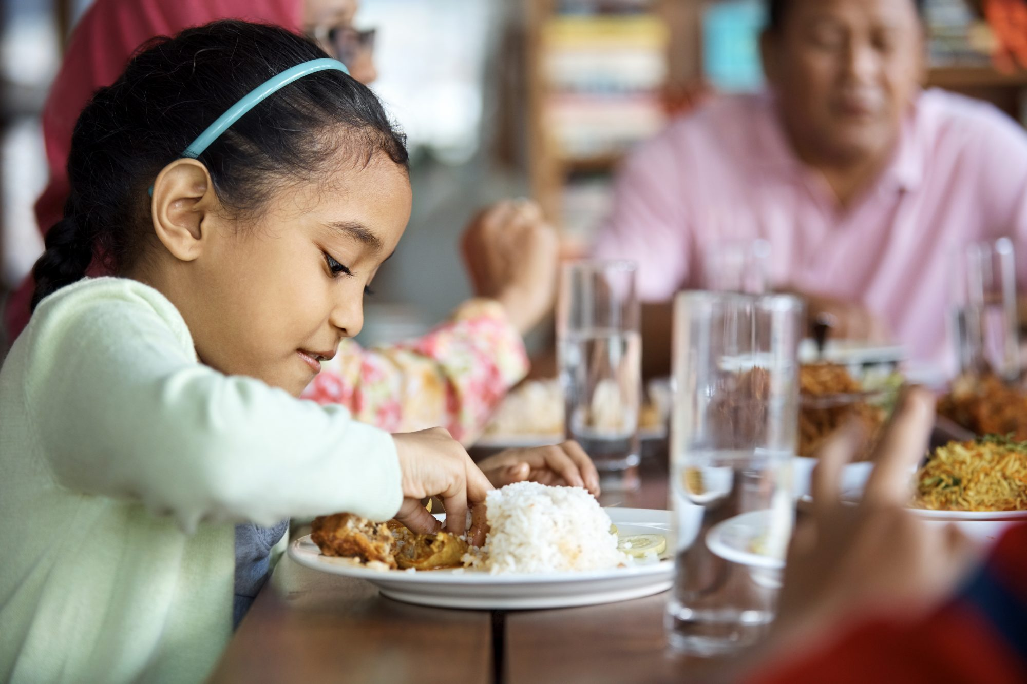 Kid Eating Dinner at Table