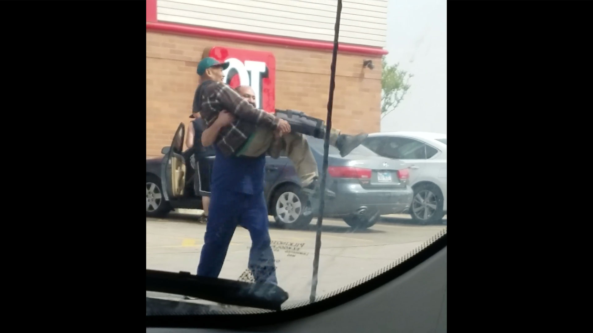 Good Samaritan Carries Struggling Old Man