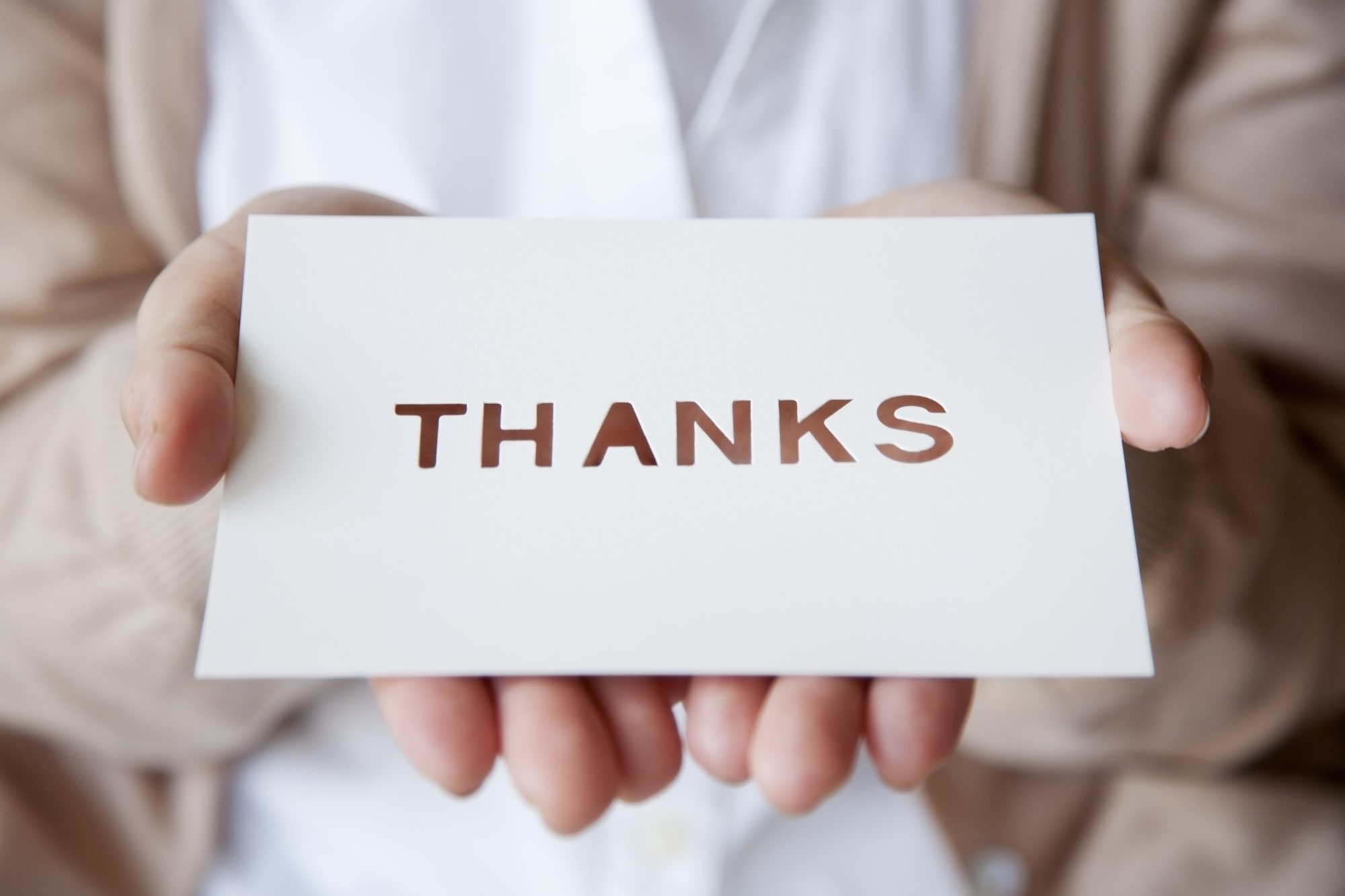 Holding a Thank You Note