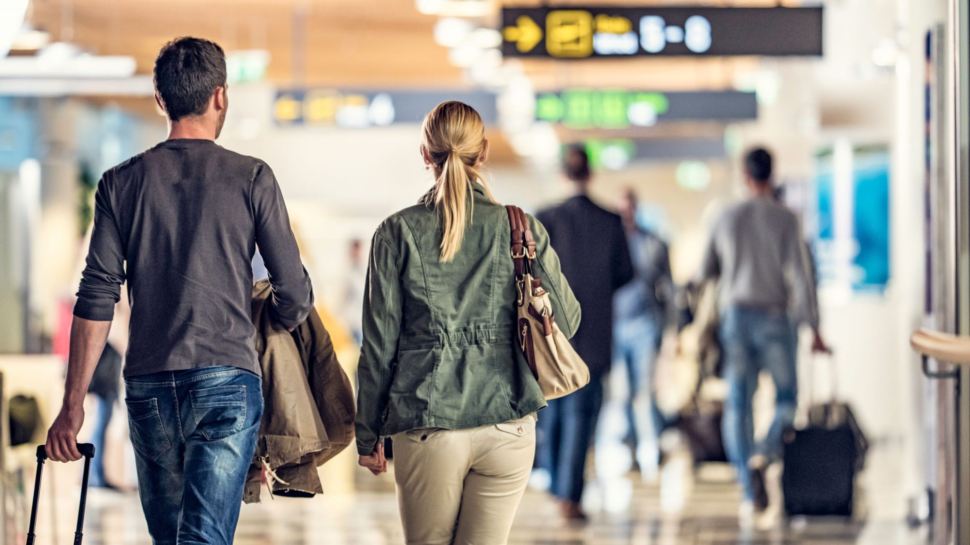 Couple Walking Through Airport Lobby