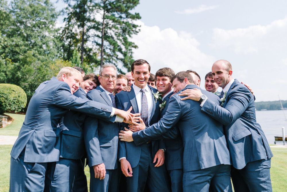 Groomsmen Hugging and Laughing in Suits
