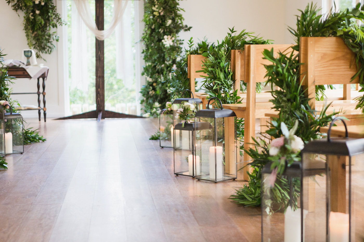 Wedding Aisle with Lanterns and Greenery