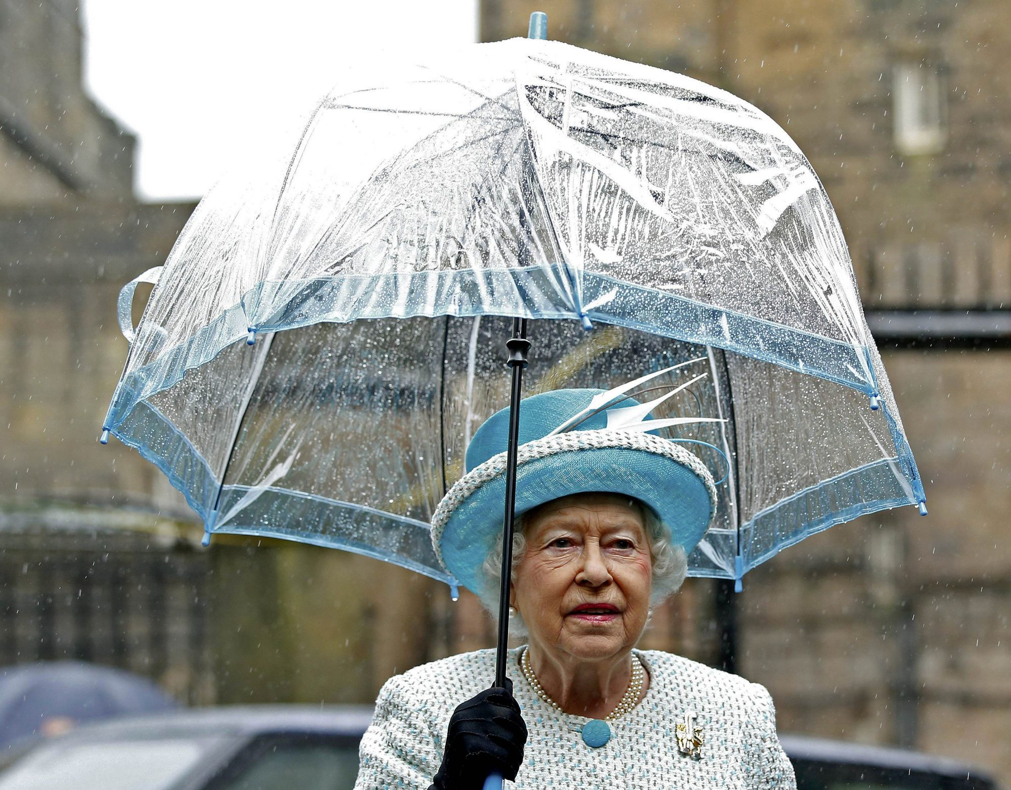 Queen Elizabeth and Blue Umbrella