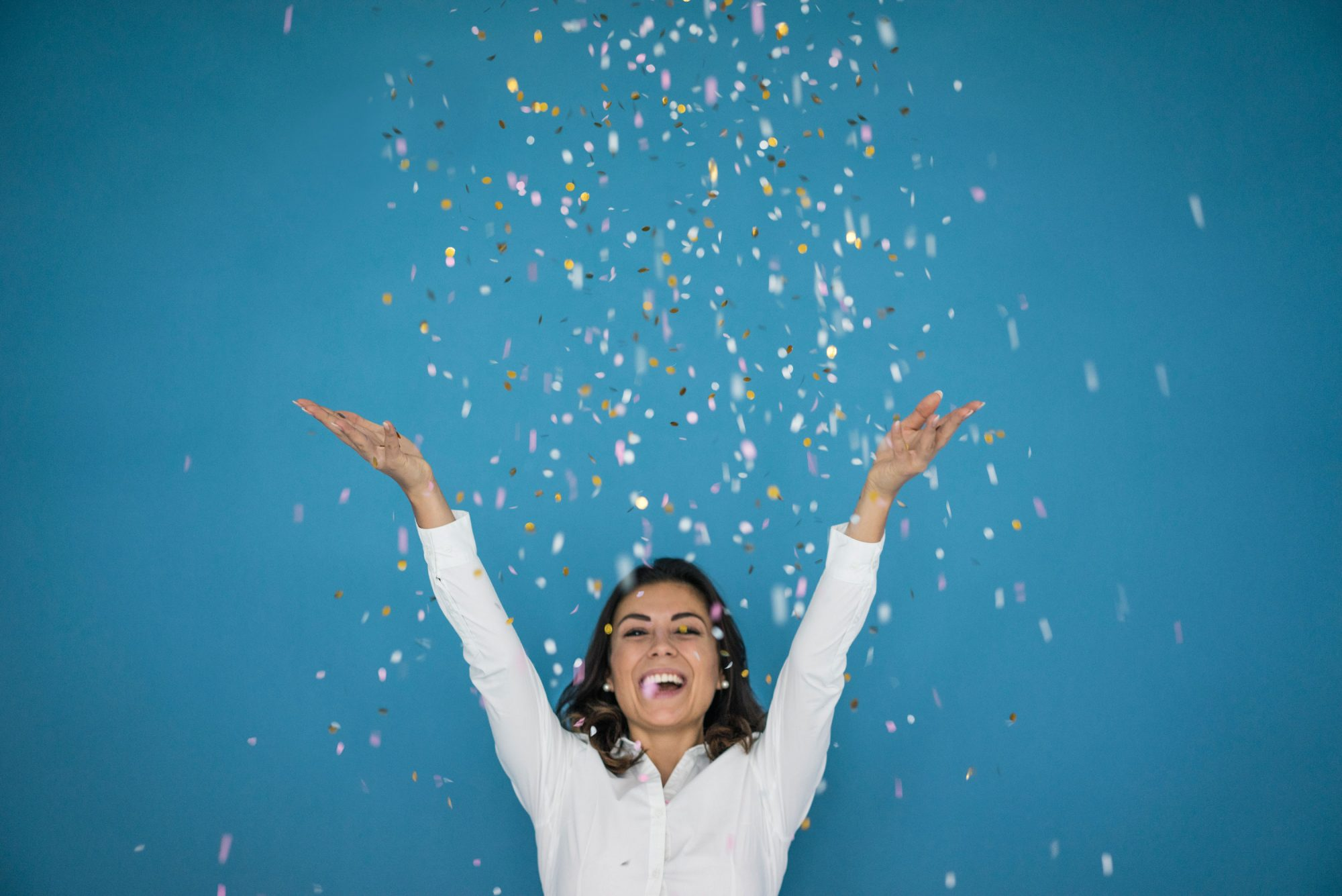 Woman Celebrating with Confetti