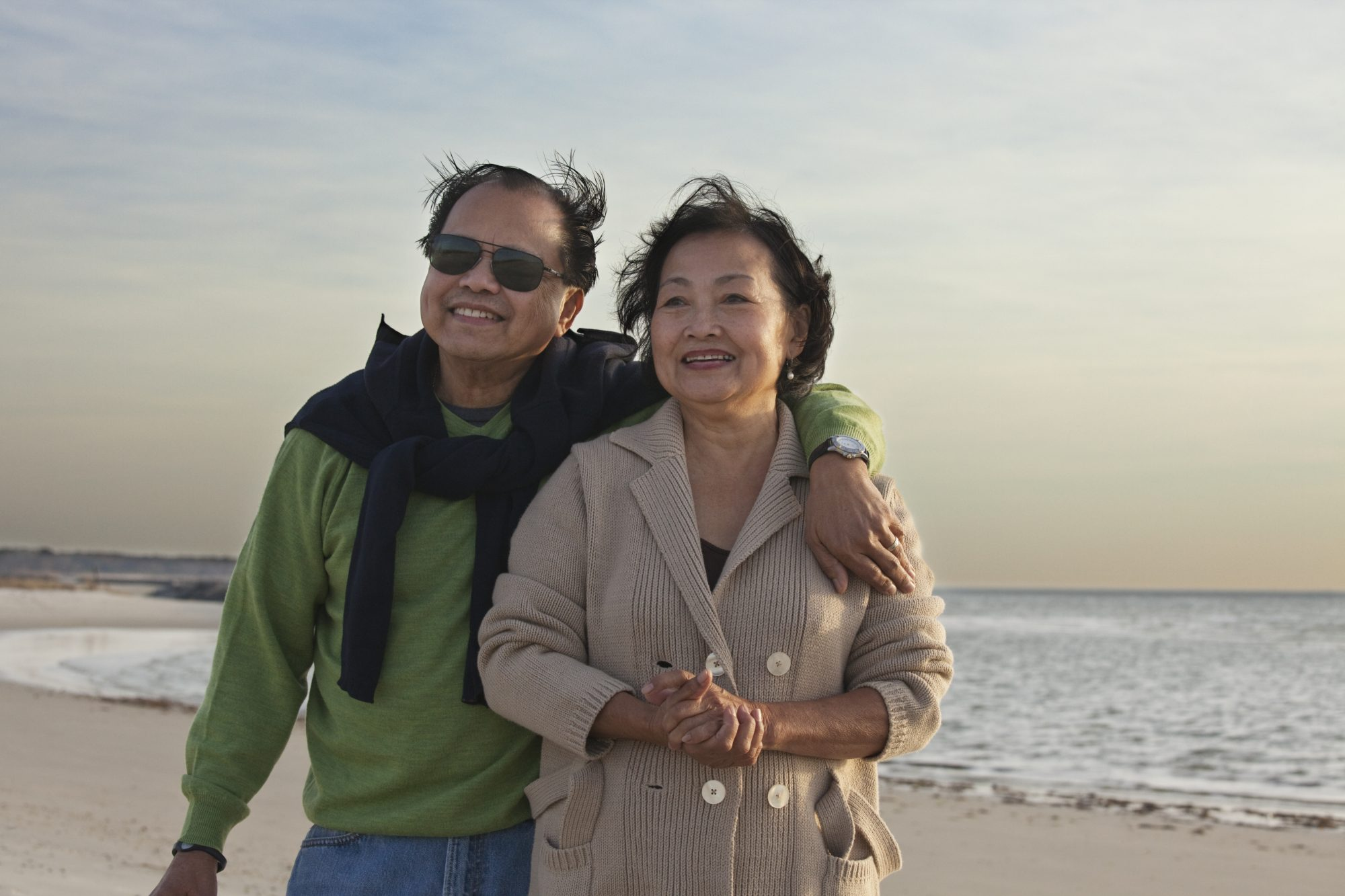 Older Couple Smiling on Beach