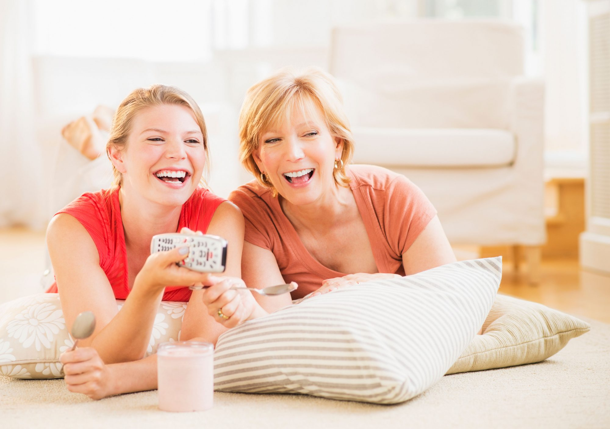 Mother and Daughter Watching a Movie and Eating Ice Cream