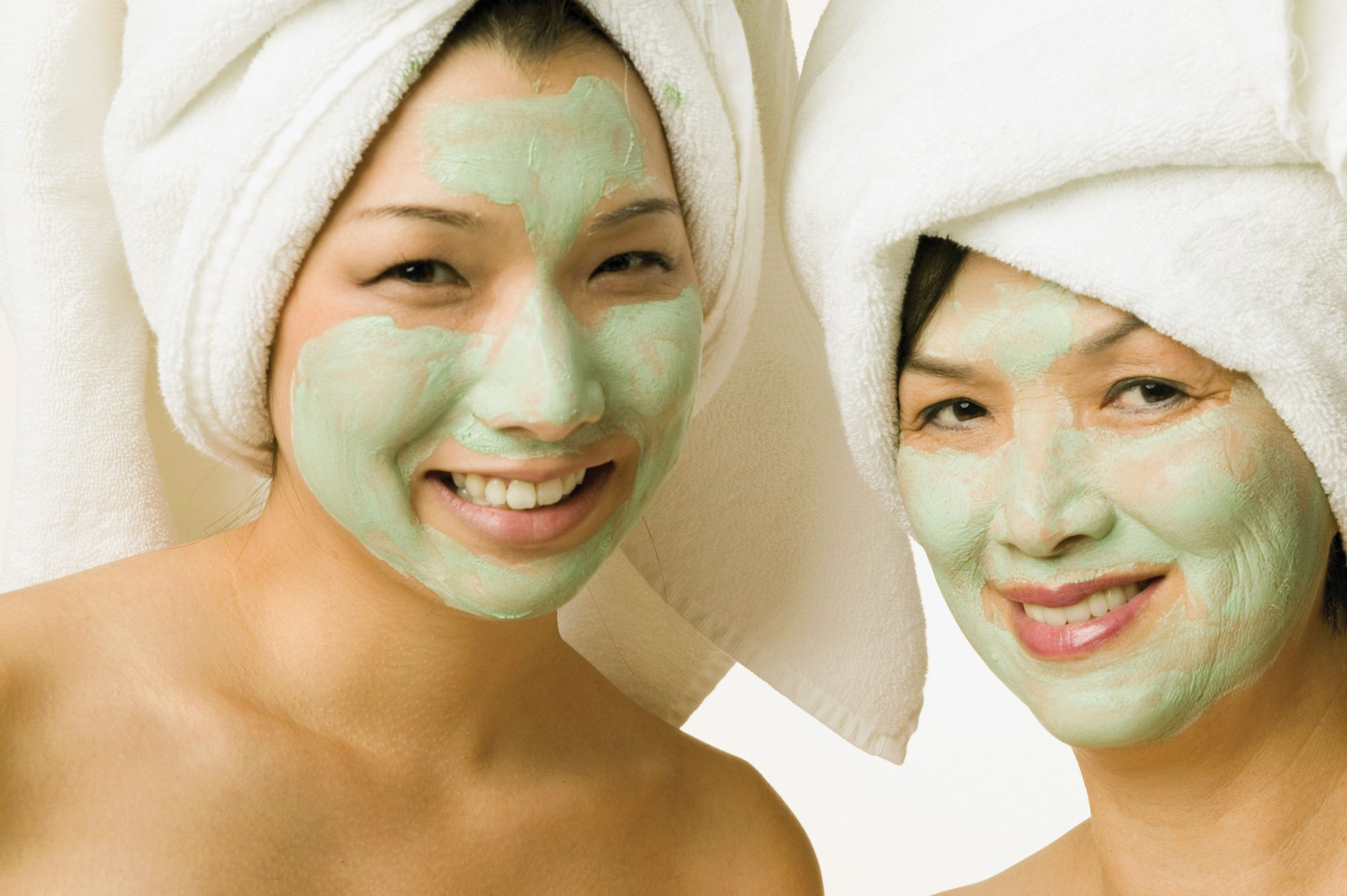 Mother and Daughter with Facials and Towels for Spa Day