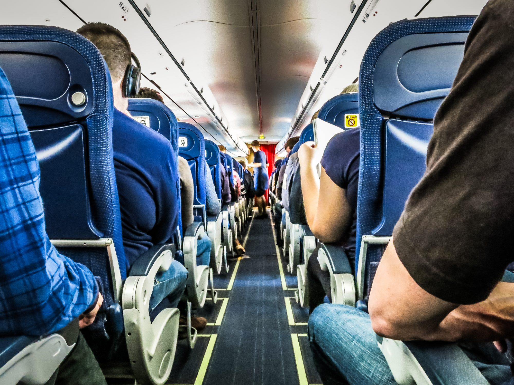 Airplane Passengers in Seats