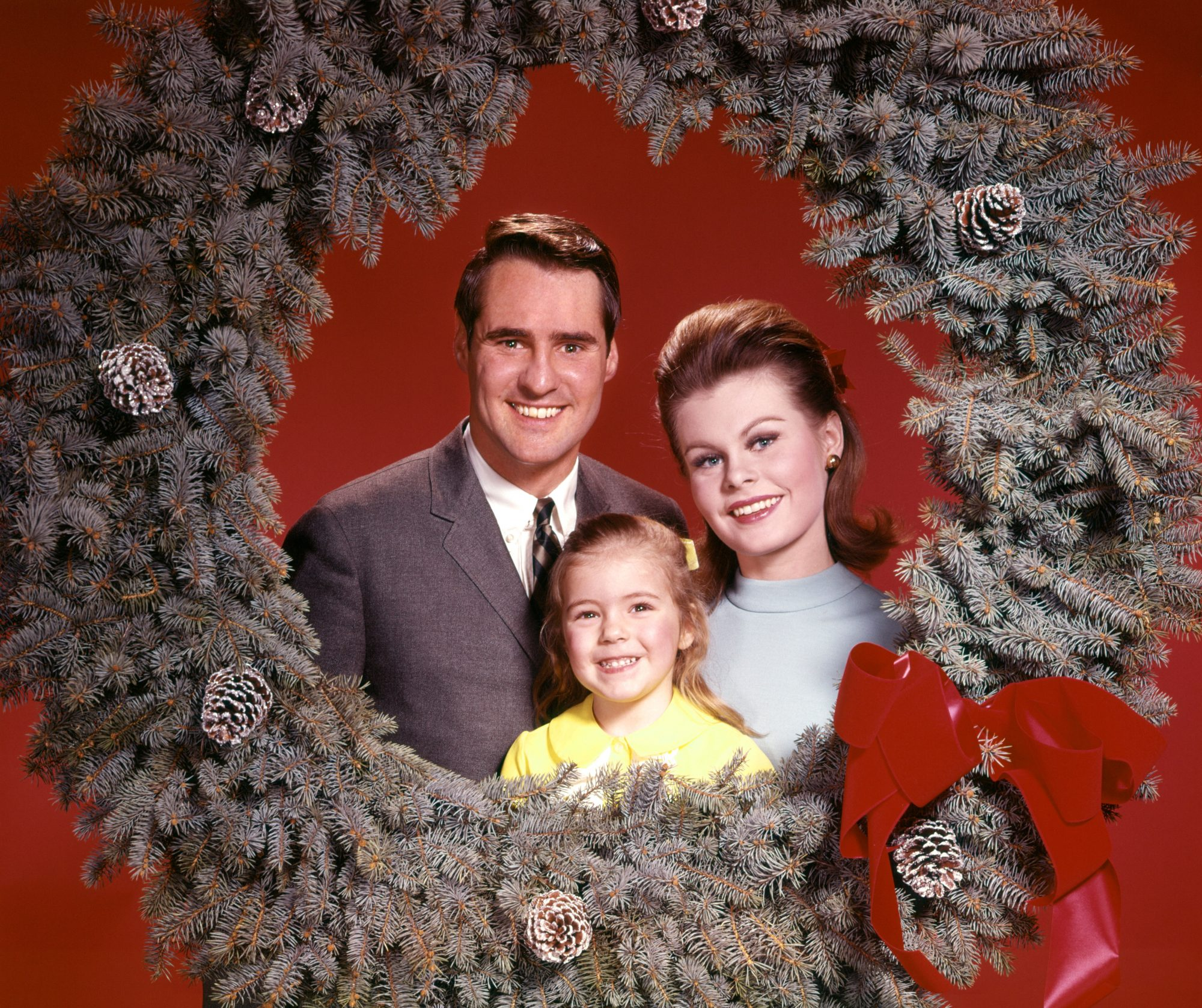 Happy Family Posing with Christmas Wreath