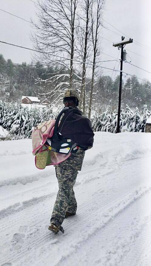 National Guardsman Carries Baby